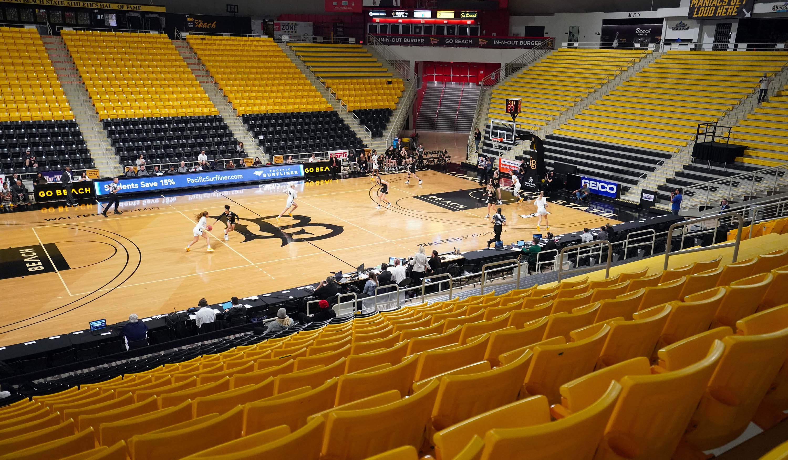 The Long Beach State and Cal Poly women's basketball teams play in an empty Walter Pyramid arena during the Big West tournament in Long Beach, California on March 10.