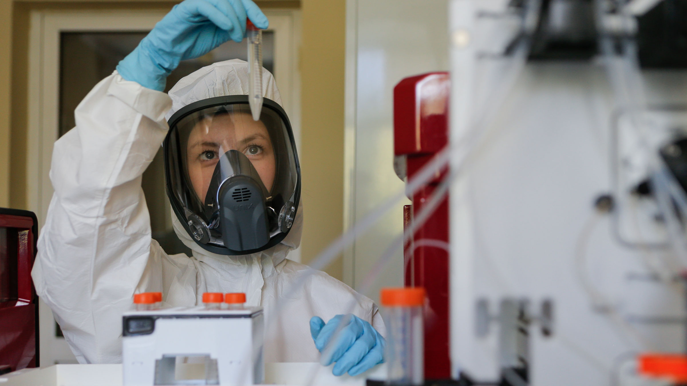 An employee works with a coronavirus vaccine in this photo provided by the Russian Direct Investment Fund on August 6.