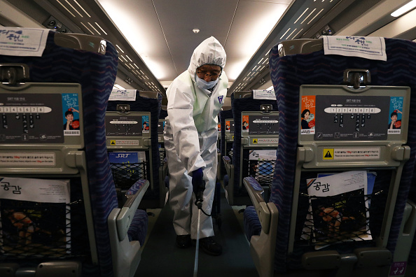 A disinfection worker wearing protective gear sprays antiseptic solution in a train on January 24, 2020, in Seoul, South Korea.