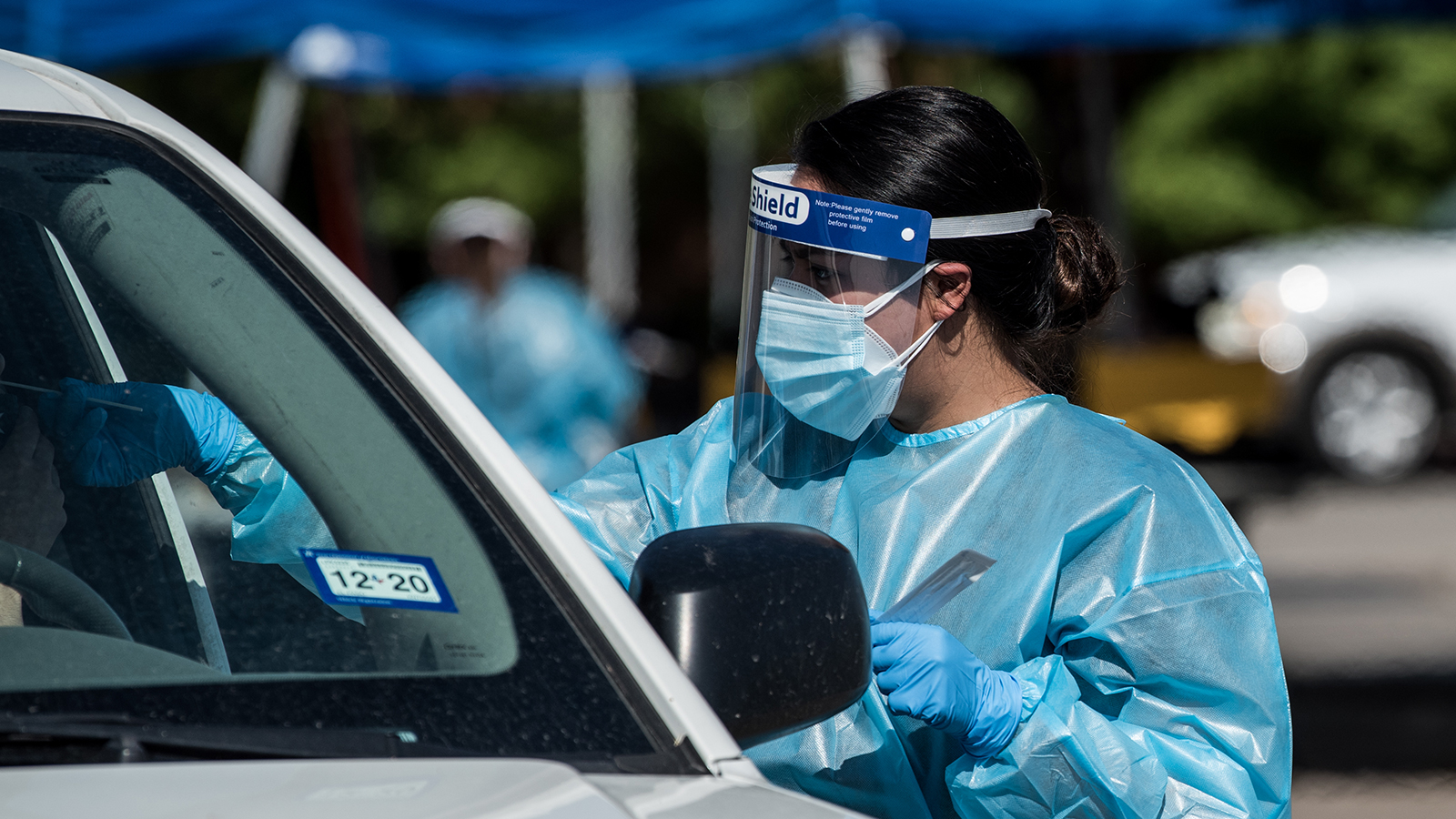 A nurse conducts a coronavirus test at a newly opened mega drive-thru site at El Paso Community College Valle Verde campus on July 21 in El Paso.