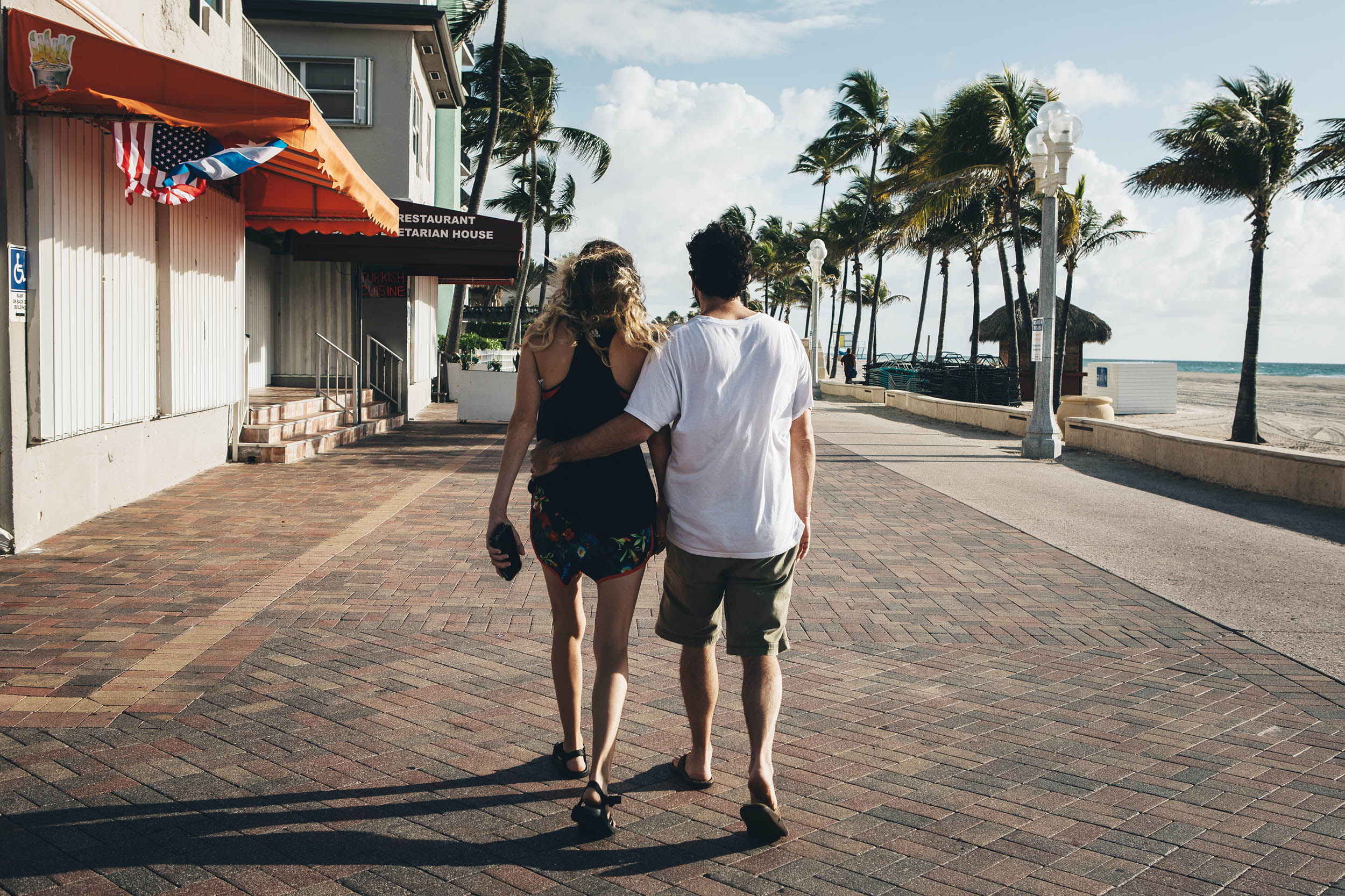 A couple walks along the Hollywood Boardwalk in Hollywood, Florida, on Saturday, May 23.