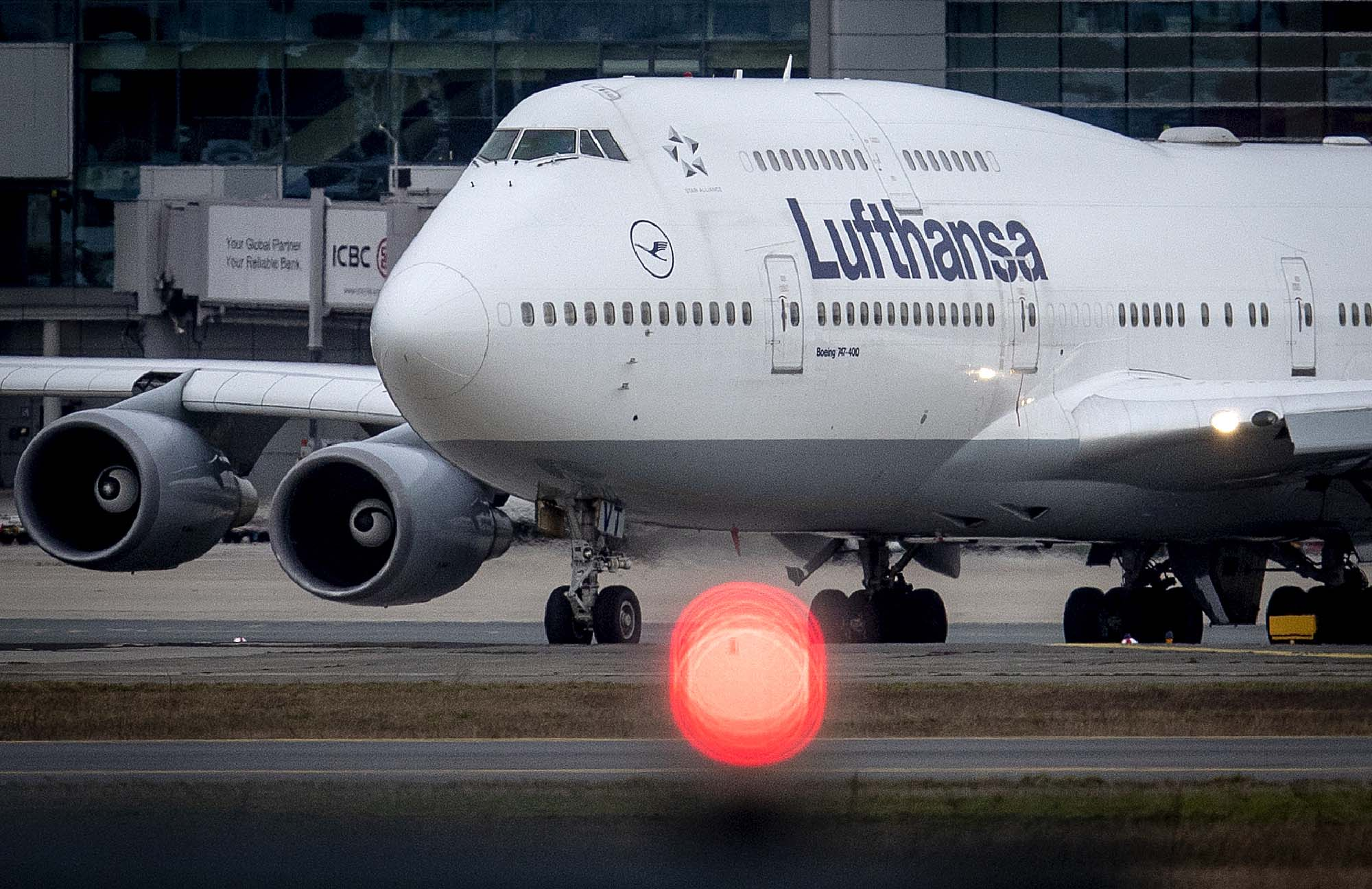 A Lufthansa plane rolls over the runway at an airport in Frankfurt, Germany, on March 1.