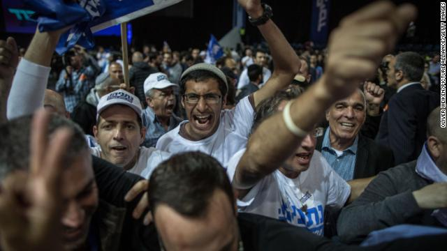 Supporters of sitting Israeli Prime Minister Benjamin Netanyahu and his Likud party react after hearing the first exit polls.