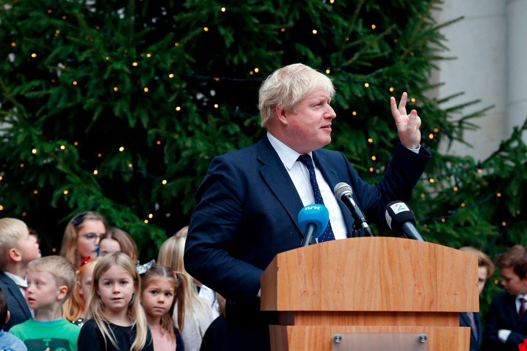 Boris Johnson unveils a Christmas tree at the Foreign Office in 2017.