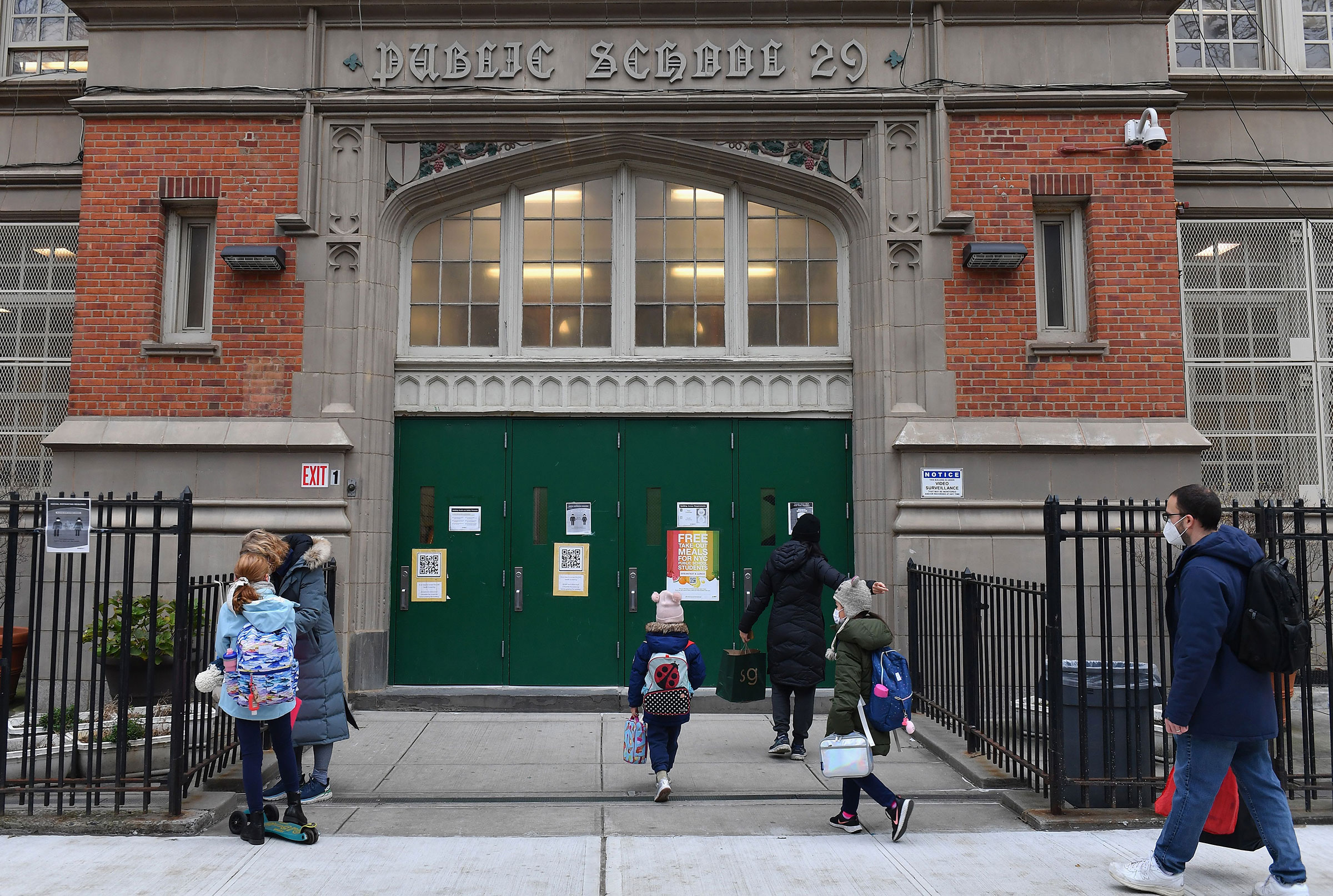 Children arrive for class on the first day of school reopening on December 7 in New York.