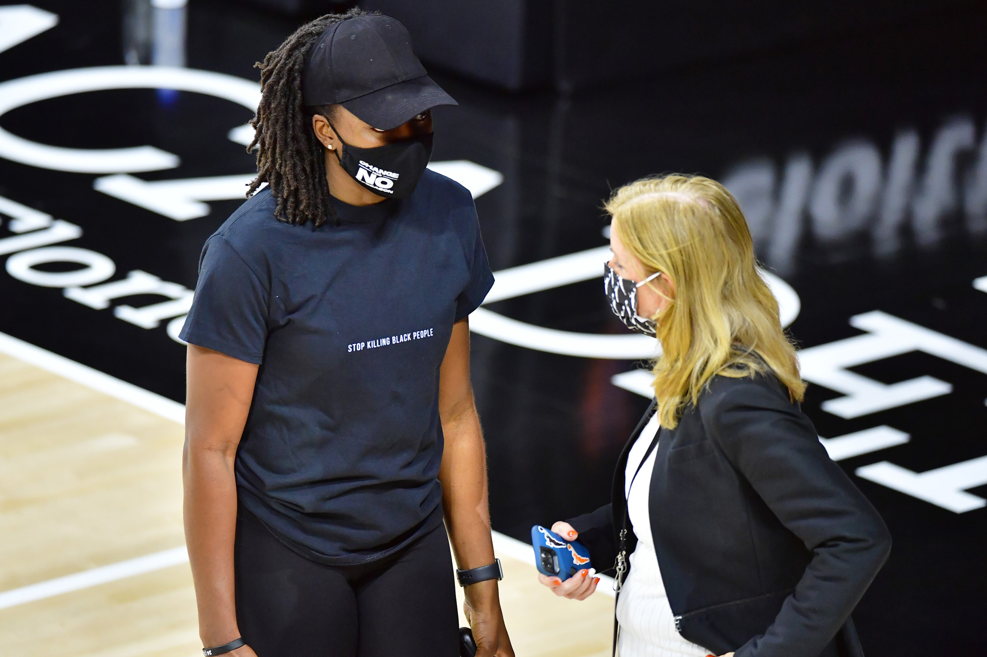 Nneka Ogwumike, president of The Women's National Basketball Players Association, left, speaks with WNBA commissioner Cathy Engelbert at Feld Entertainment Center on August 26 in Palmetto, Florida.