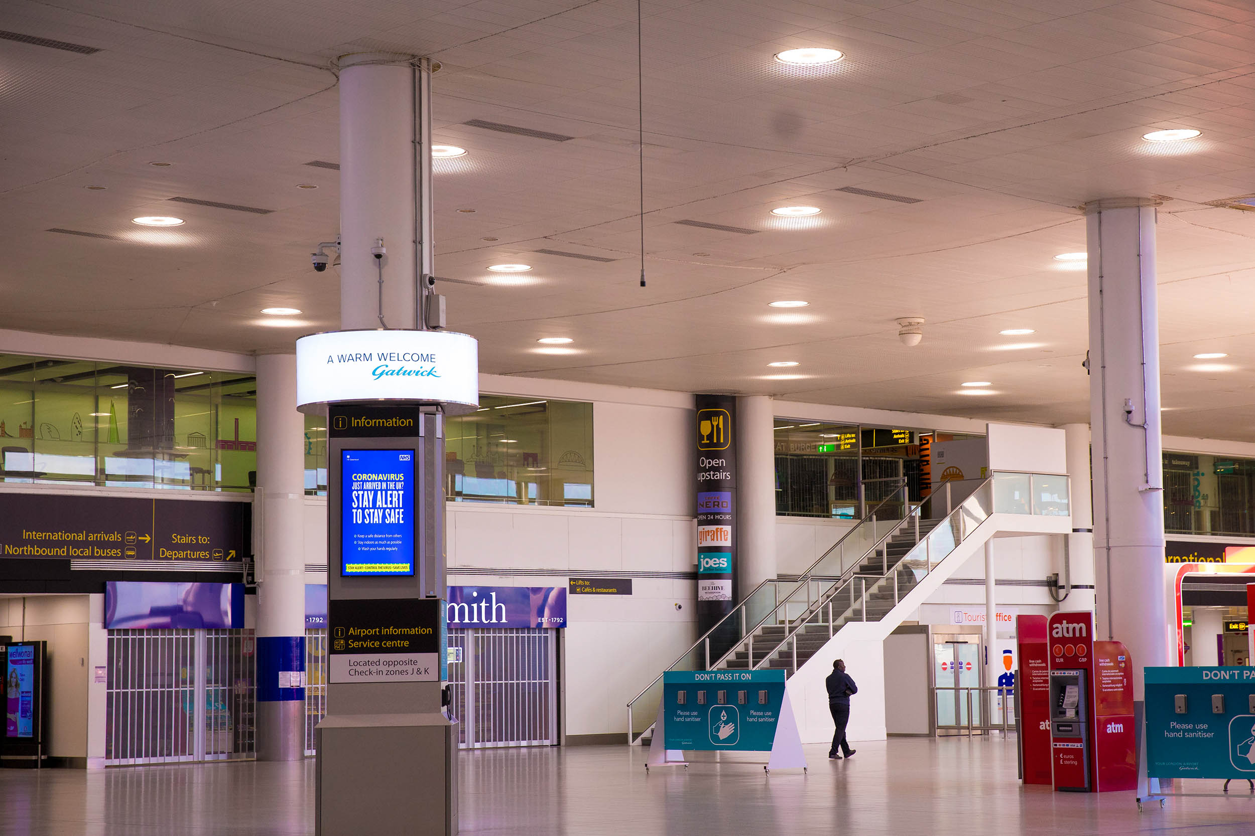 Retail outlets are closed in the South Terminal at London Gatwick Airport in London, England, on Monday, May 18.