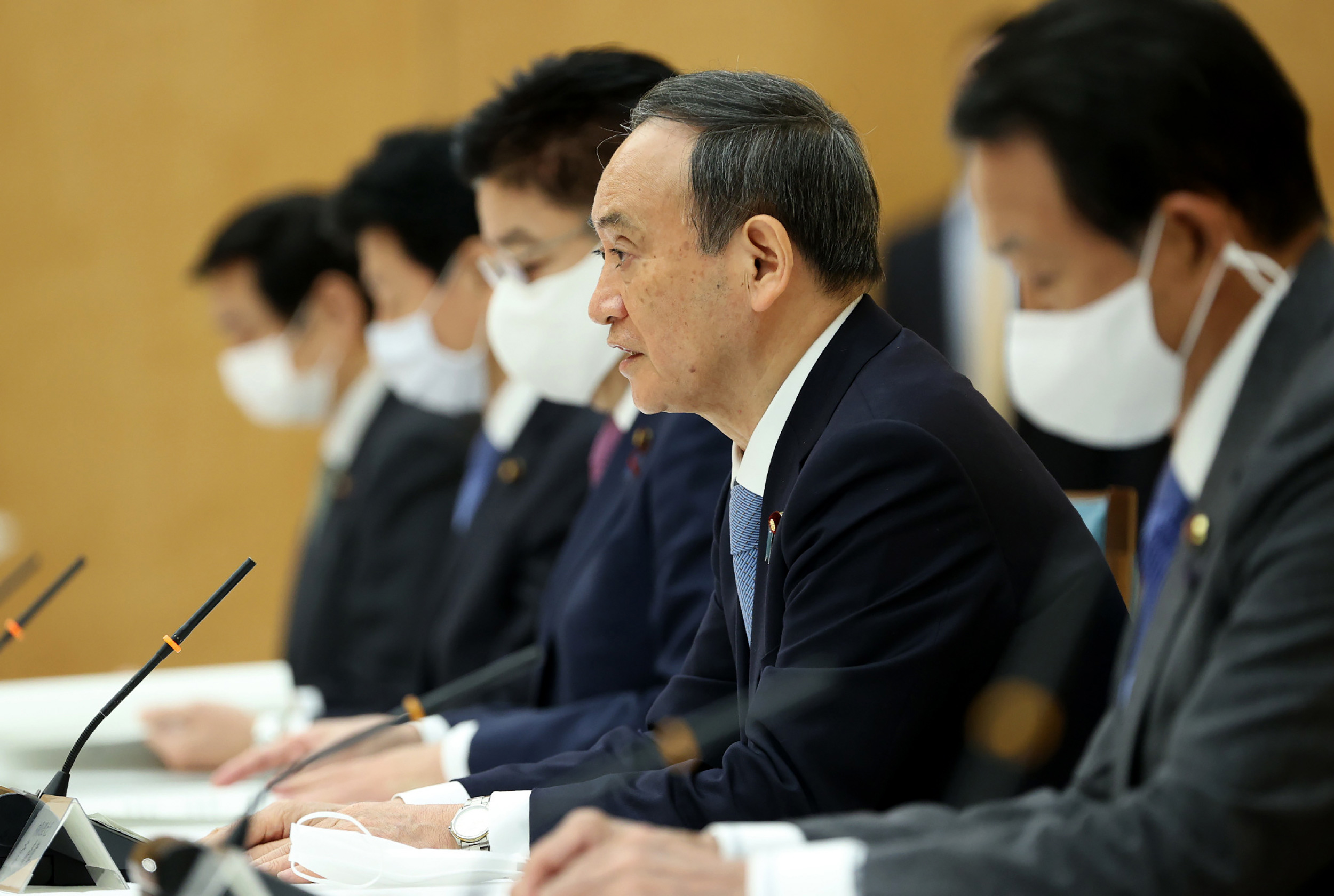 Japanese Prime Minister Yoshihide Suga, second from right, speaks at a meeting of the government and ruling parties policy at the prime minister's office in Tokyo on December 8.