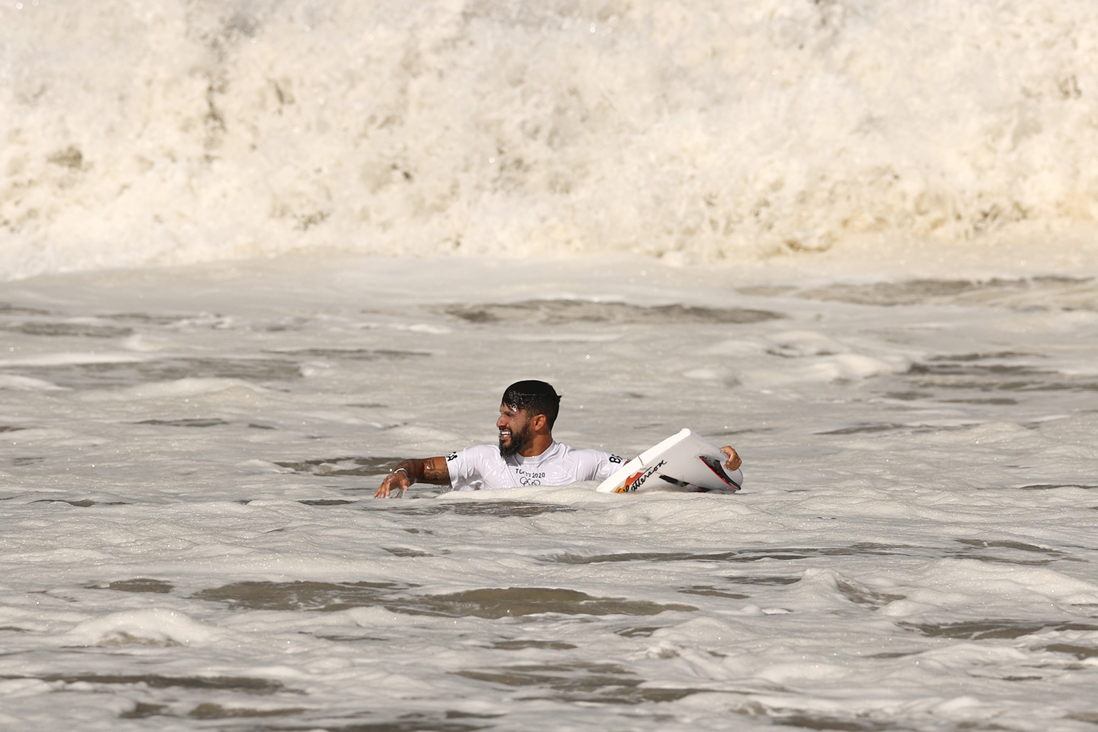Italo Ferreira holds a broken board on his opening wave of the men's Gold Medal match at Tsurigasaki Surfing Beach on July 27.