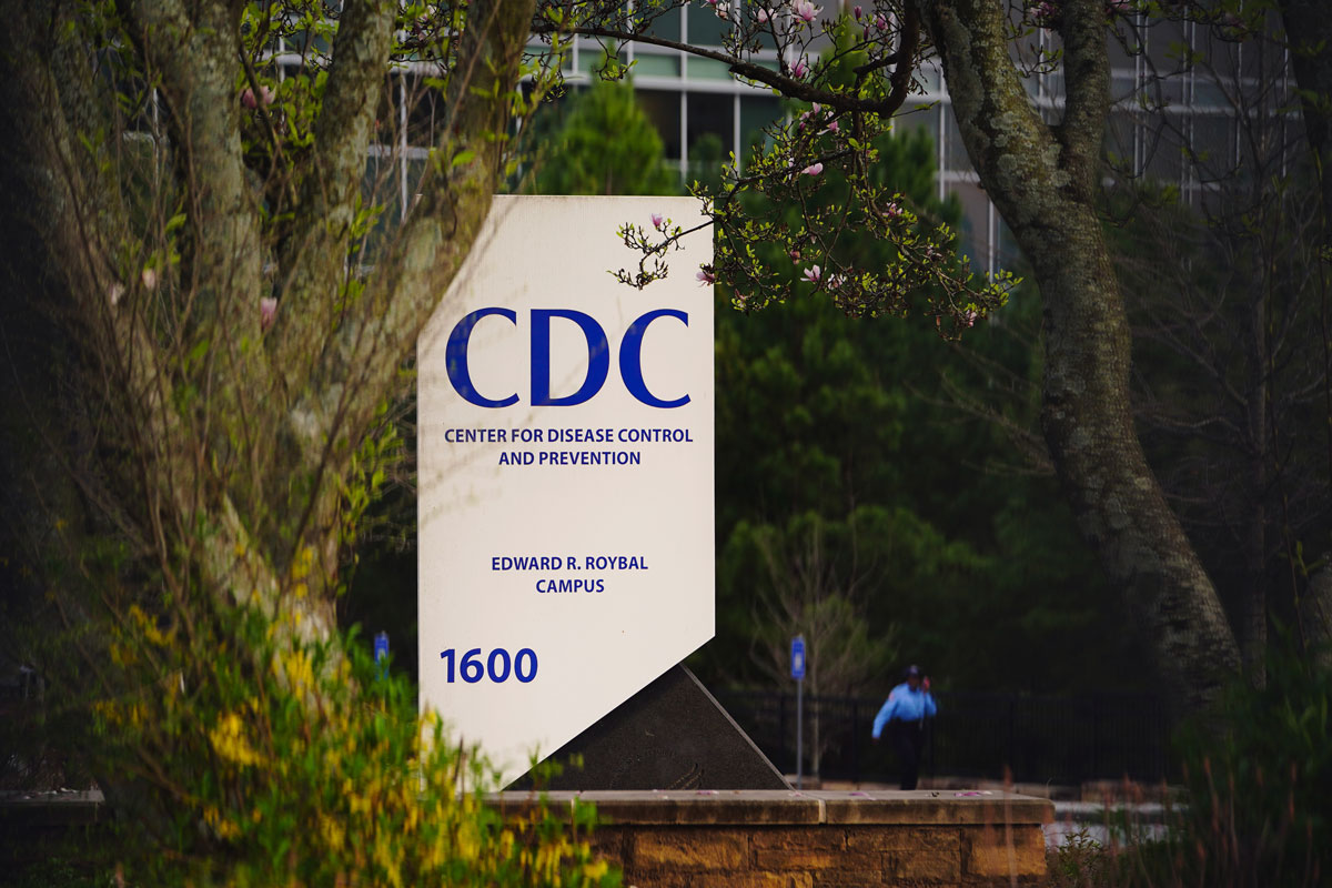 A security guard walks on the grounds of the Centers for Disease Control and Prevention headquarters in Atlanta, Georgia, on March 14.