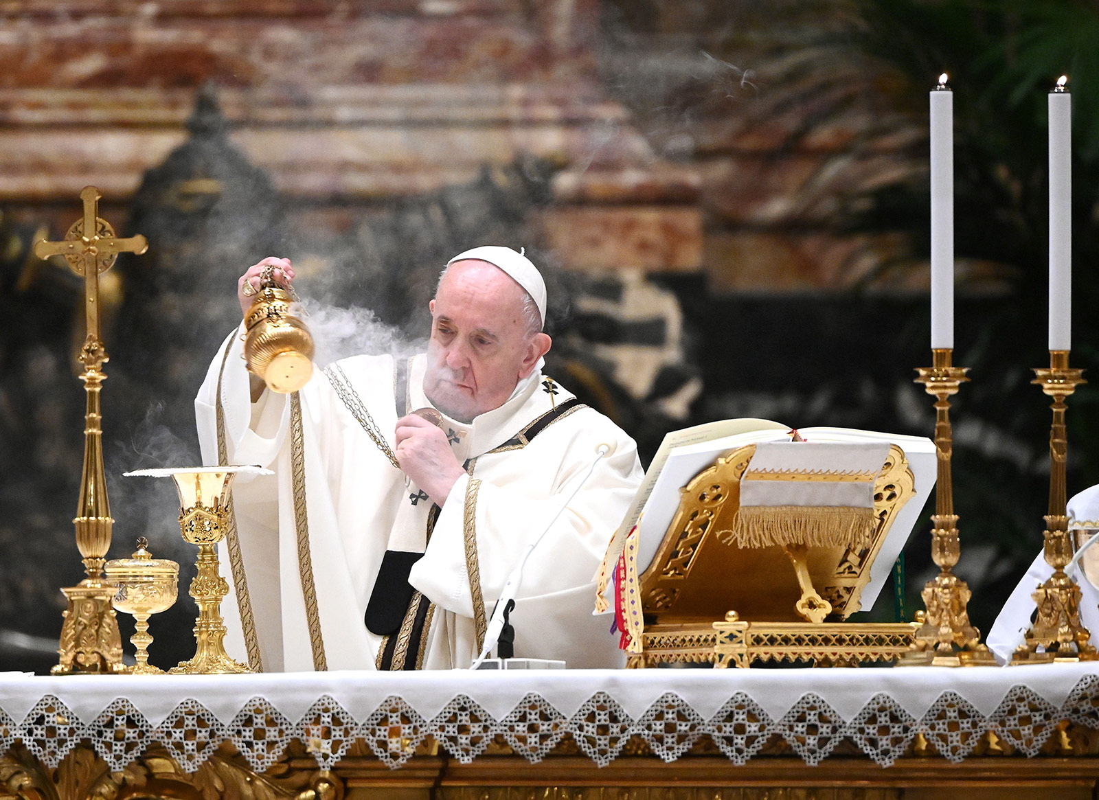 Pope Francis leads a Christmas Eve mass at St. Peter's Basilica in the Vatican on December 24.