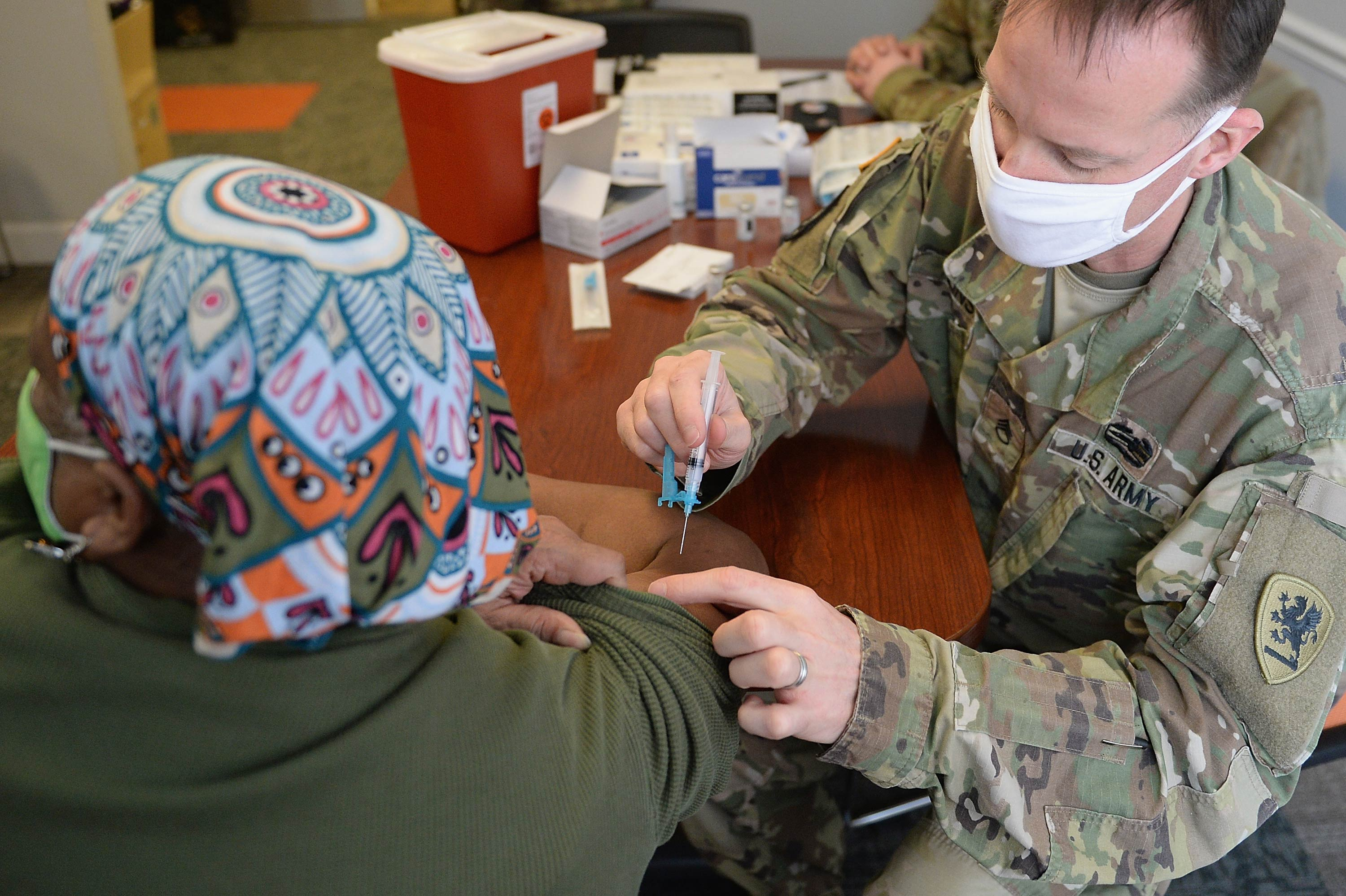 A woman receives a Covid-19 vaccine during a vaccination event on February 11 at the Jeff Vander Lou Senior living facility in St Louis, Missouri.