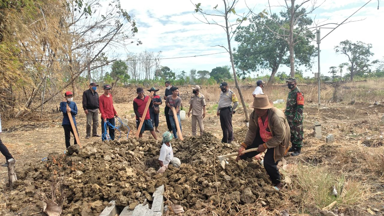 Eight people in Indonesia's Gresik Regency were forced to dig graves as punishment for not wearing masks, according to Head of Cerme Sub-district, Suyono.