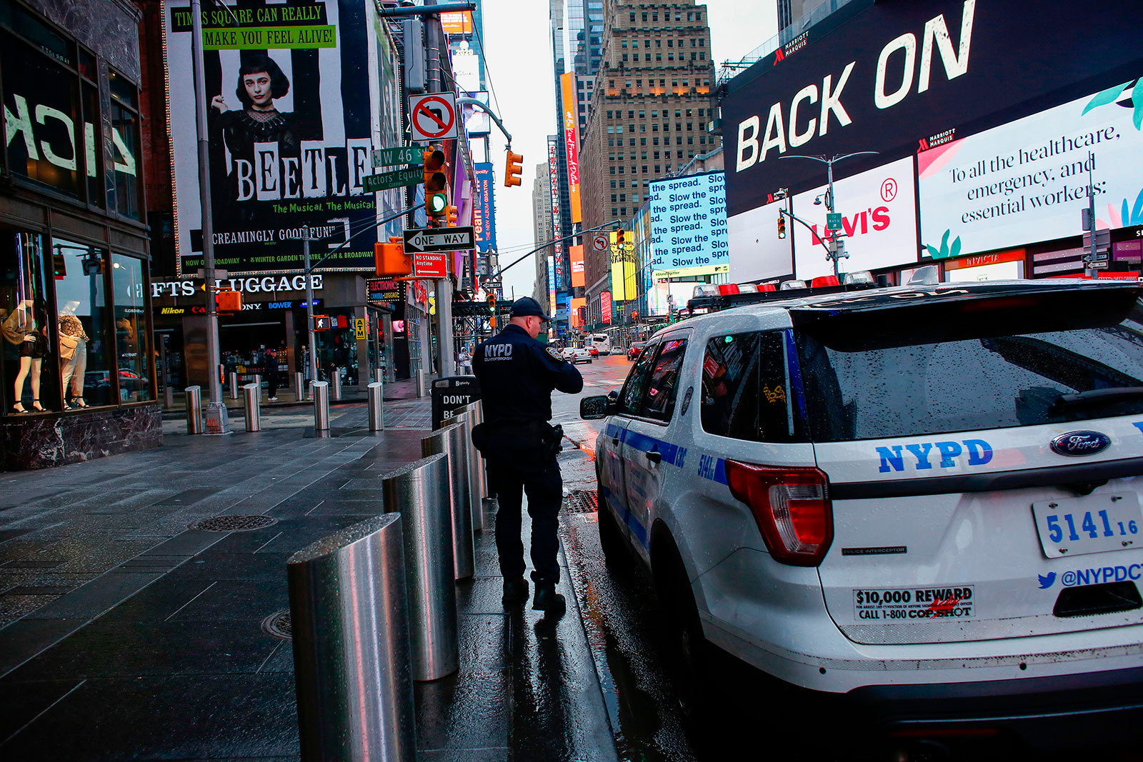 A New York police officer patrols Times Square on March 28.