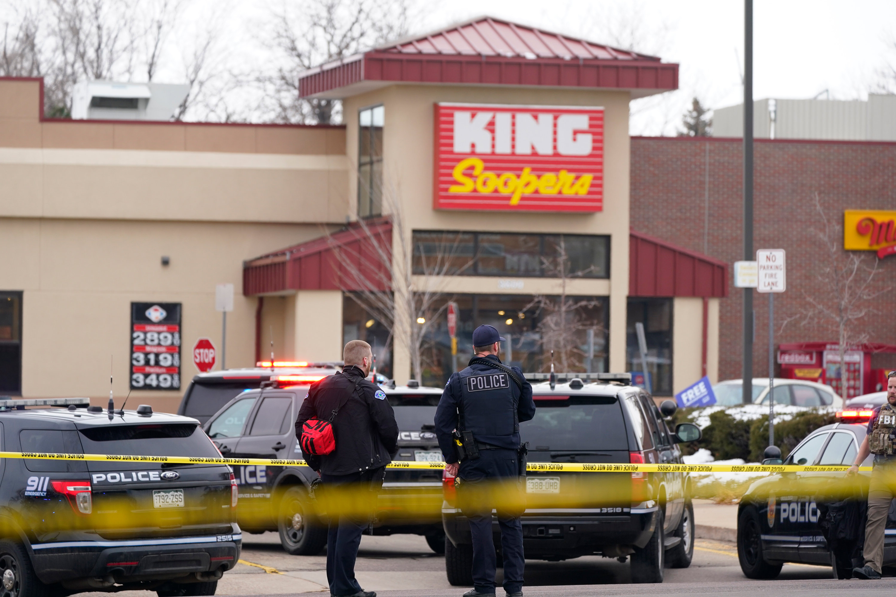 Police stand outside a King Soopers grocery store where a shooting took place on March 22 in Boulder, Colorado.