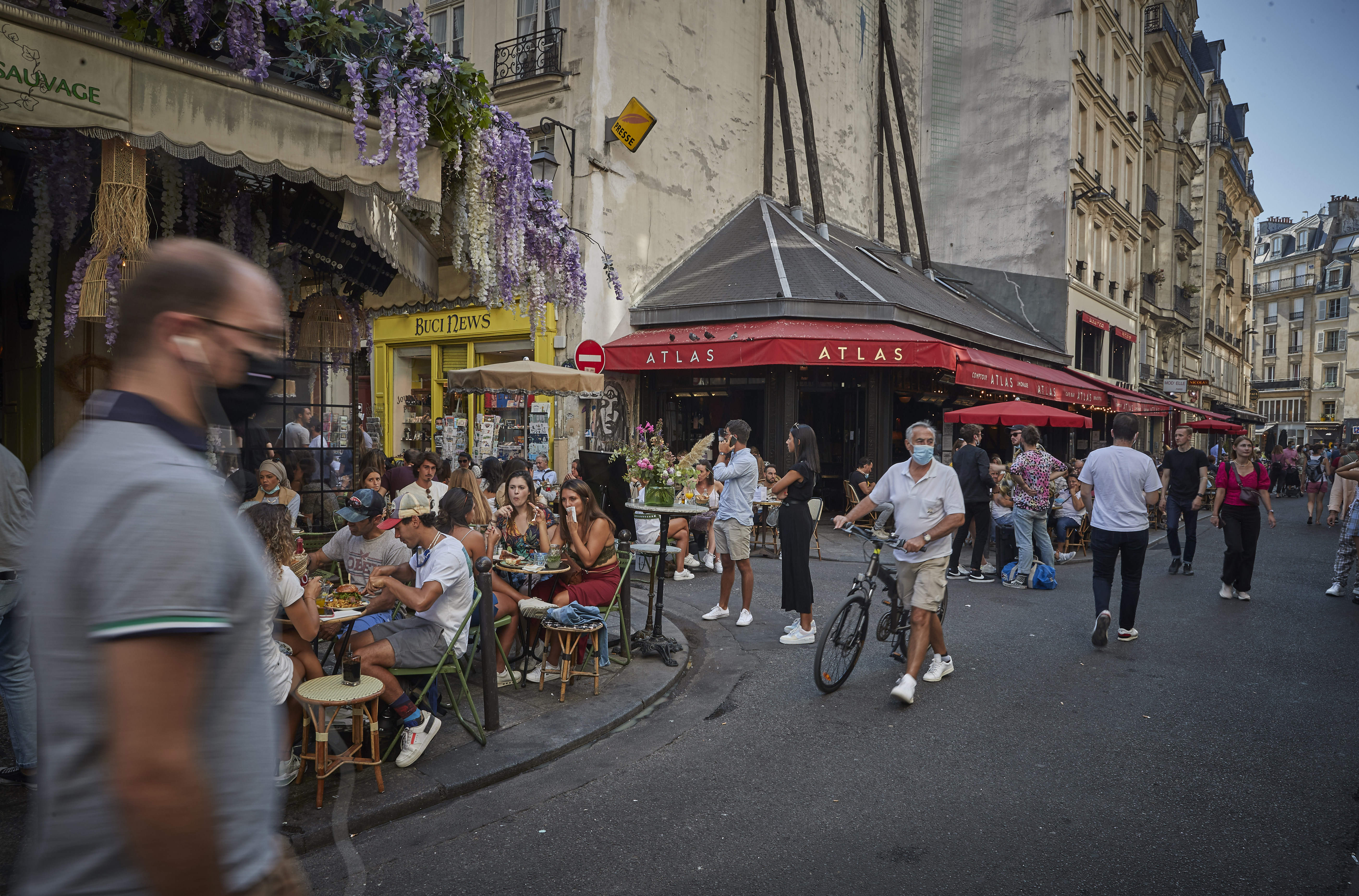 Parisians enjoy the late summer weather in packed cafes and restaurants on the Rue de Buci, Paris, despite the recent surge in Covid-19 infections throughout Paris and France on September 13.