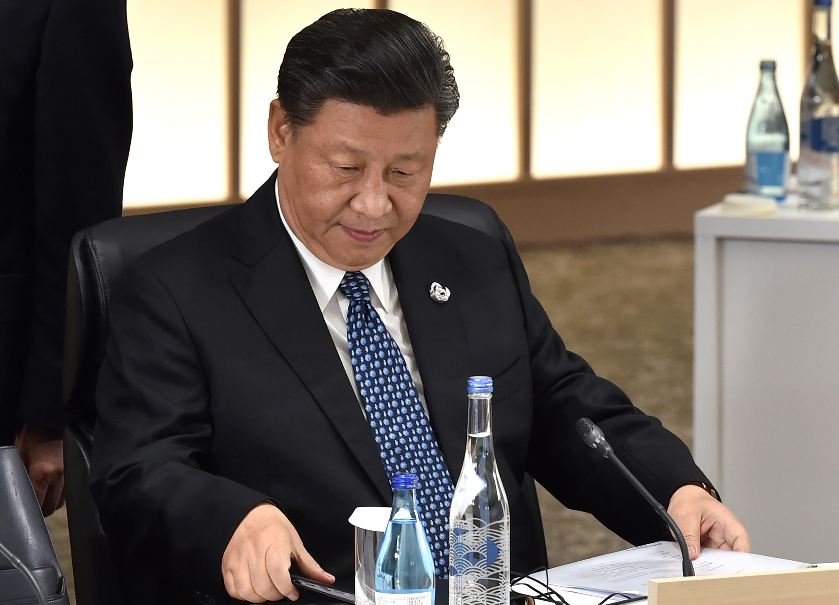 Chinese President Xi Jinping attends session 3 on women's workforce participation, future of work, and ageing societies during the G20 Summit in Osaka on June 29.
