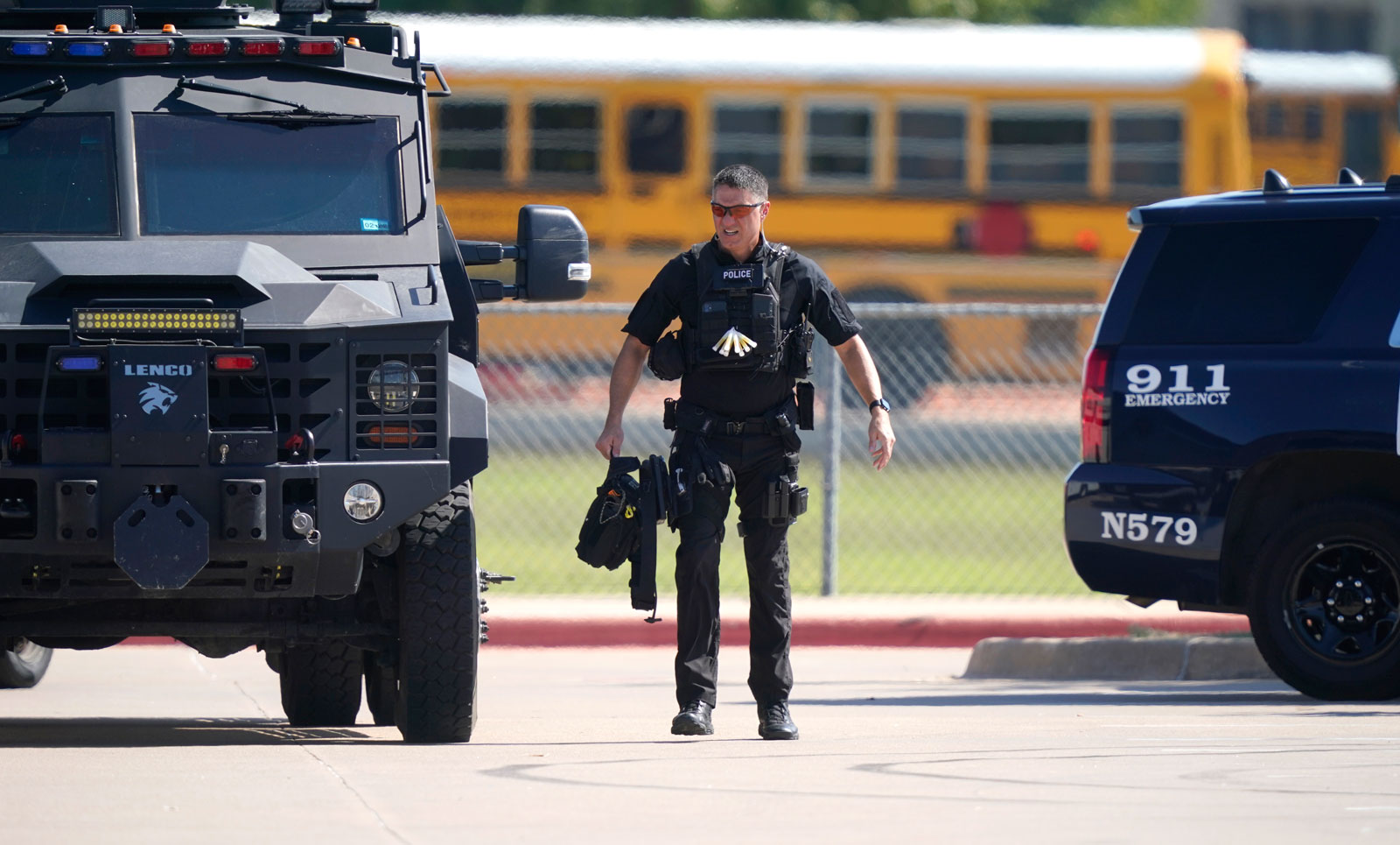 A law enforcement officer walks in the parking lot of Timberview High School after a shooting inside the school in south Arlington, Texas on October 6.
