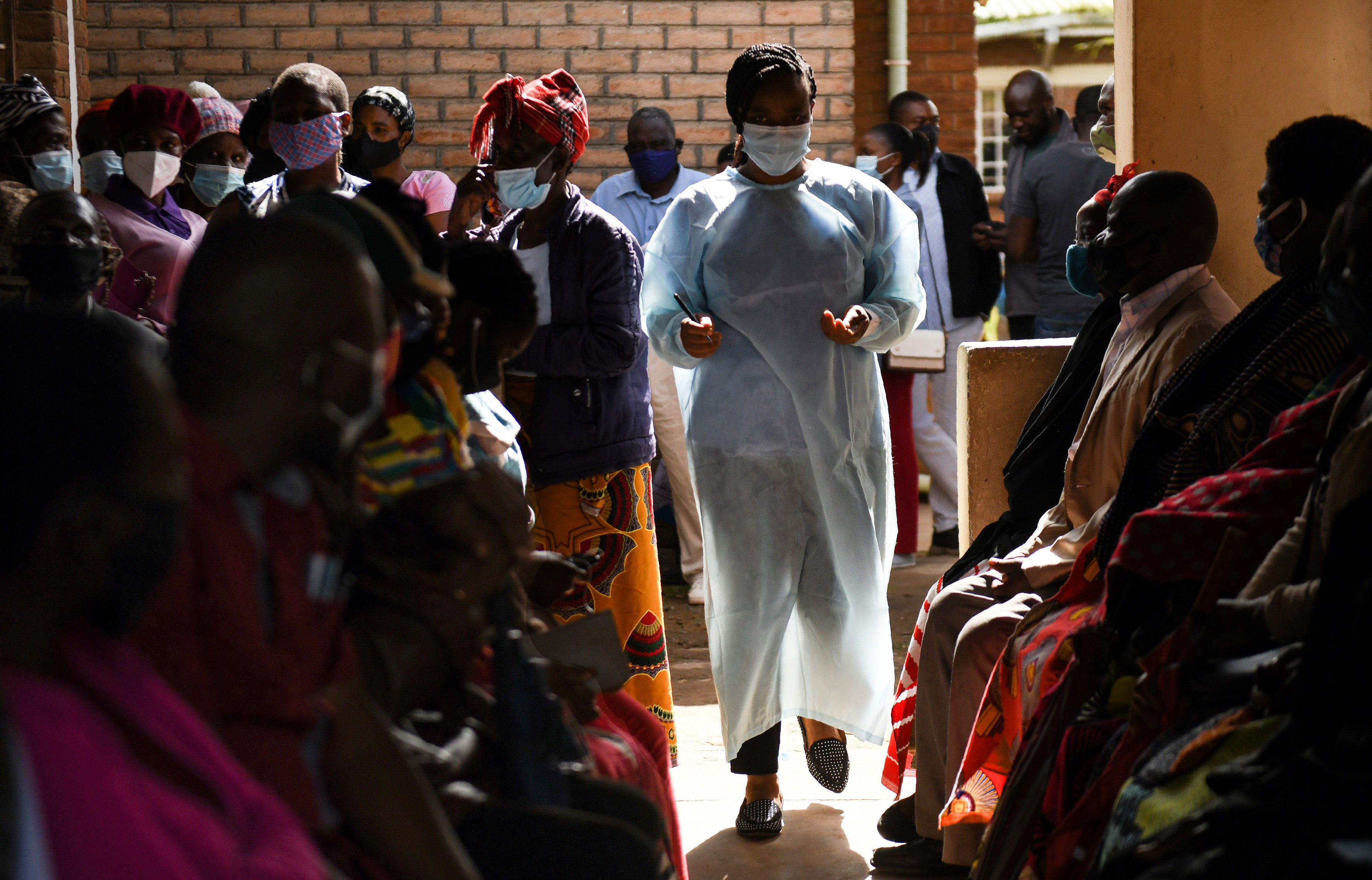Numbers are handed out to people waiting to receive the AstraZeneca Covid-19 vaccine at a health center in Blantyre, Malawi, on March 29.