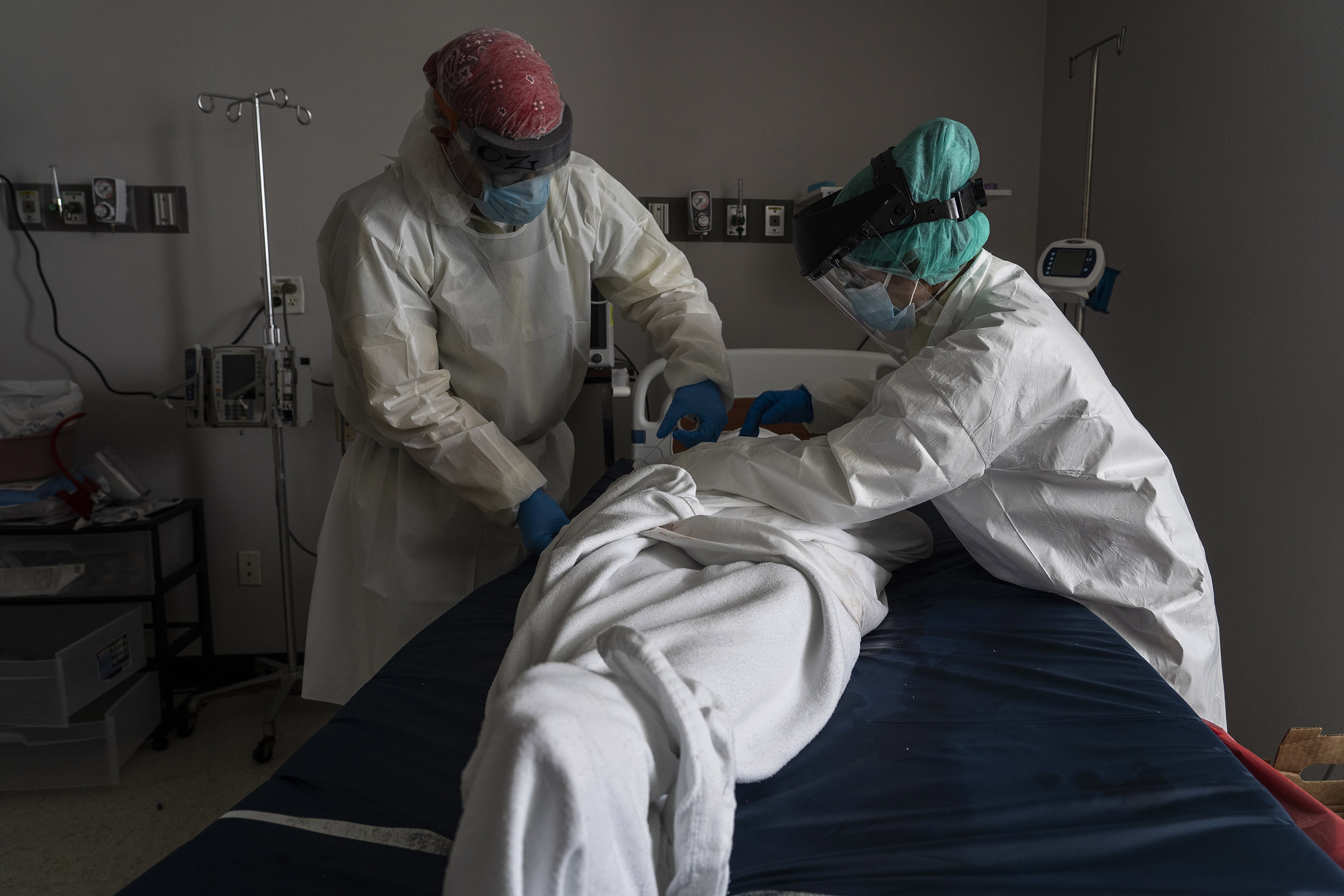 Medical staff wraps a deceased patient who died of Covid-19 in blankets at the United Memorial Medical Center on June 30, in Houston, Texas.