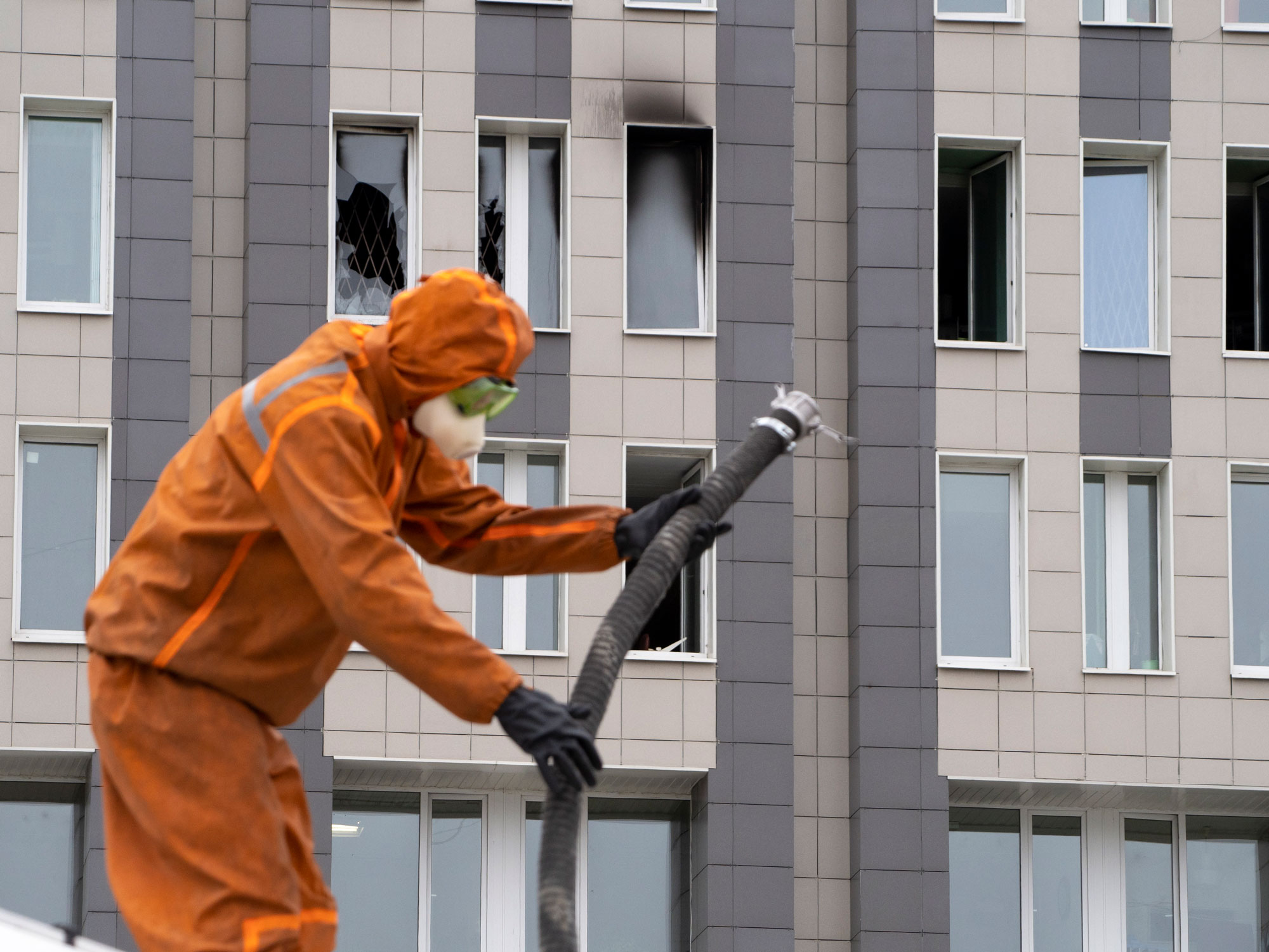 A first responder works at the scene of a fire at St. George Hospital in St. Petersburg, Russia, on Tuesday.