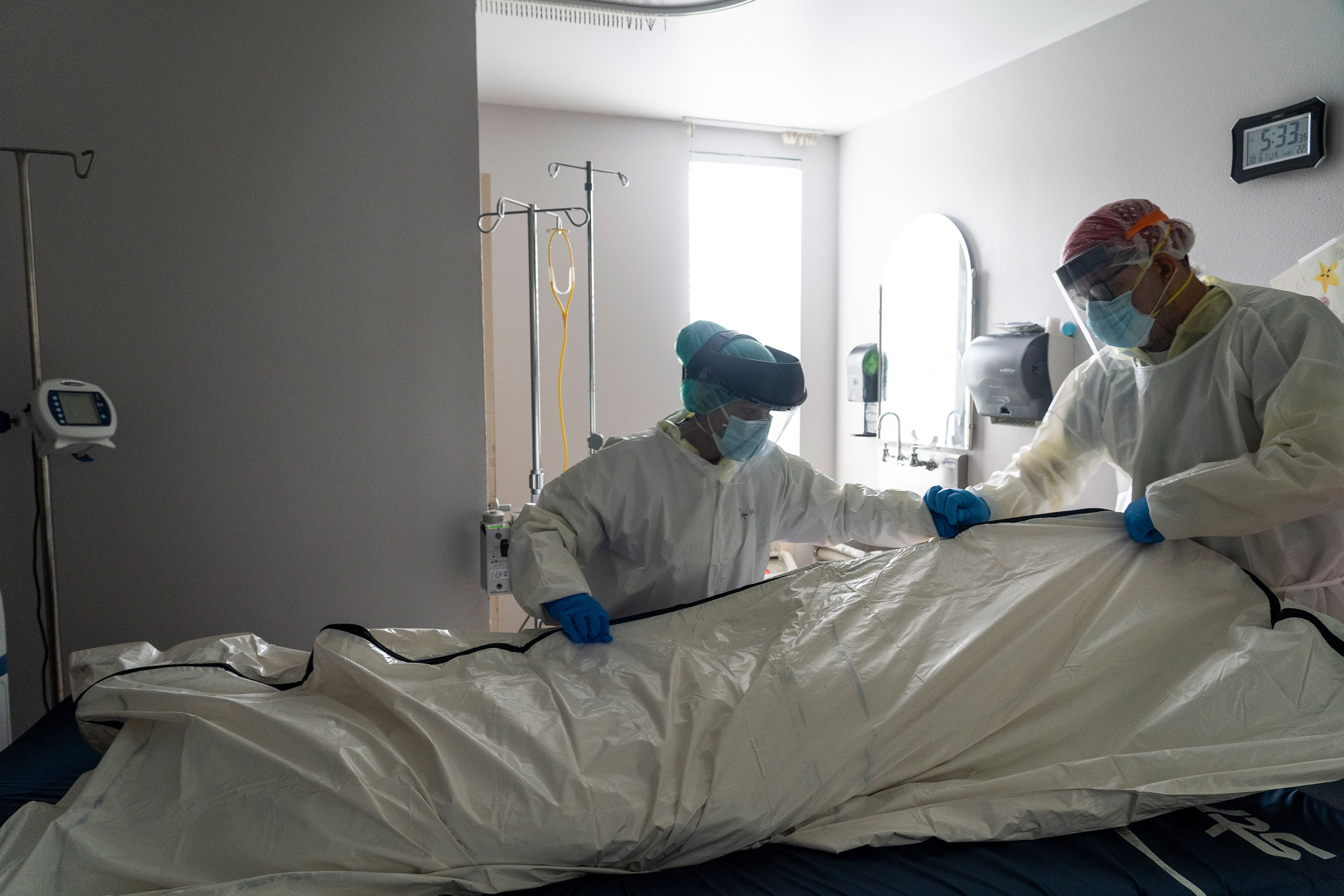 Medical staff wrap a deceased patient in a body bag in the Covid-19 intensive care unit at the United Memorial Medical Center on June 30 in Houston, Texas.
