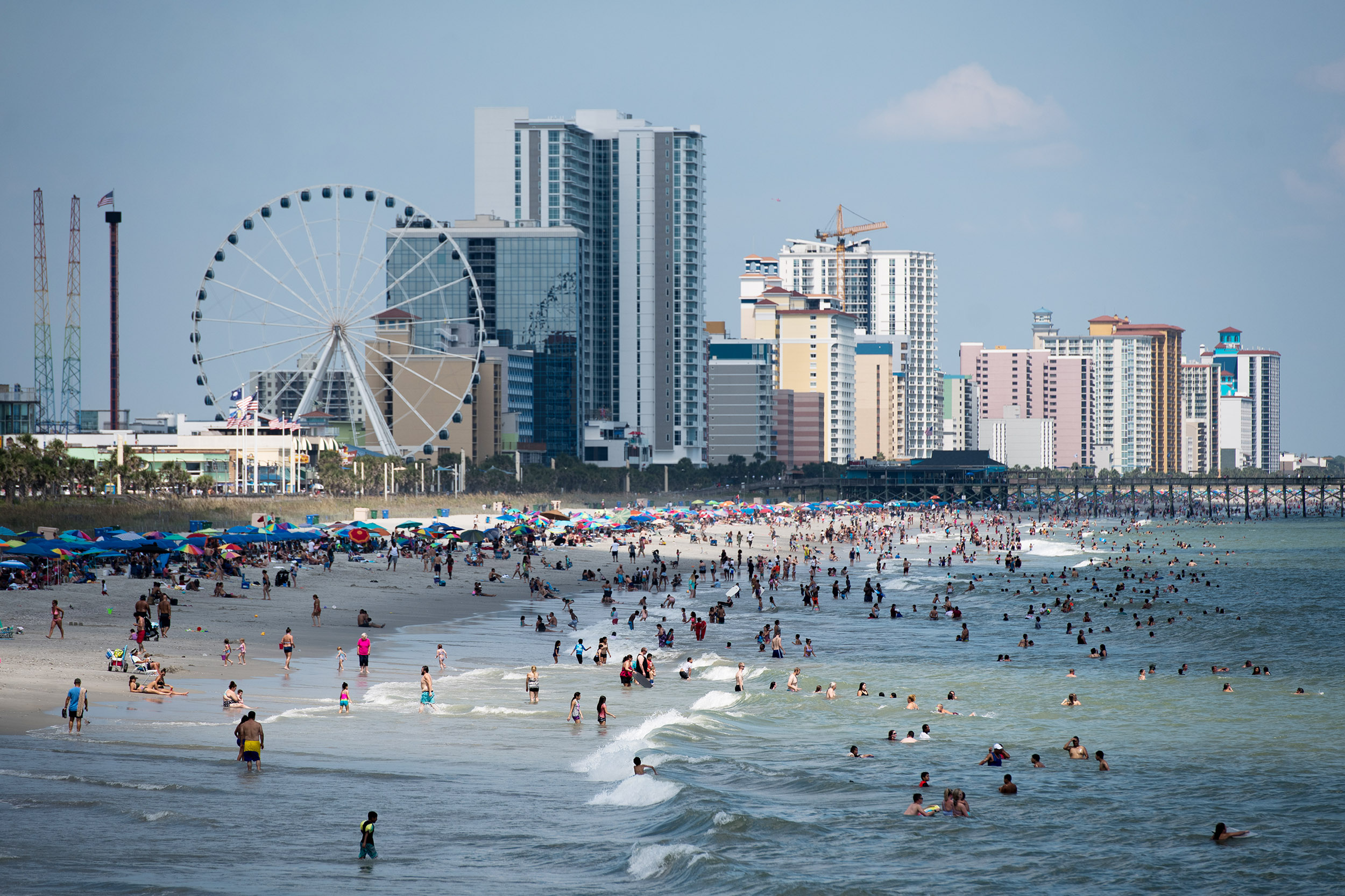 People enjoy the beach on September 5, in Myrtle Beach, South Carolina.