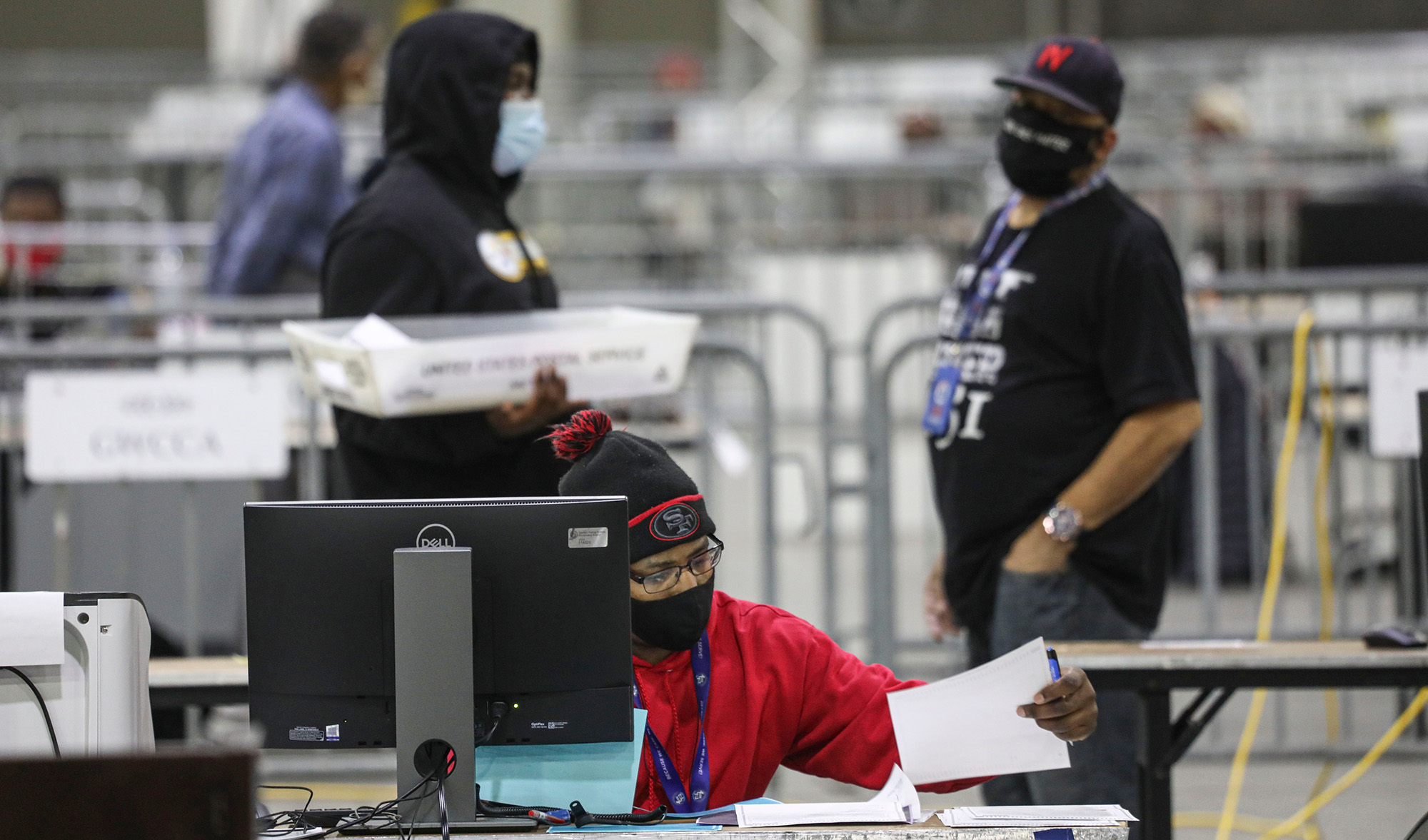 Workers scan ballots at the Georgia World Congress Center in Atlanta, Georgia on January 5, during the Georgia Senate runoff elections.