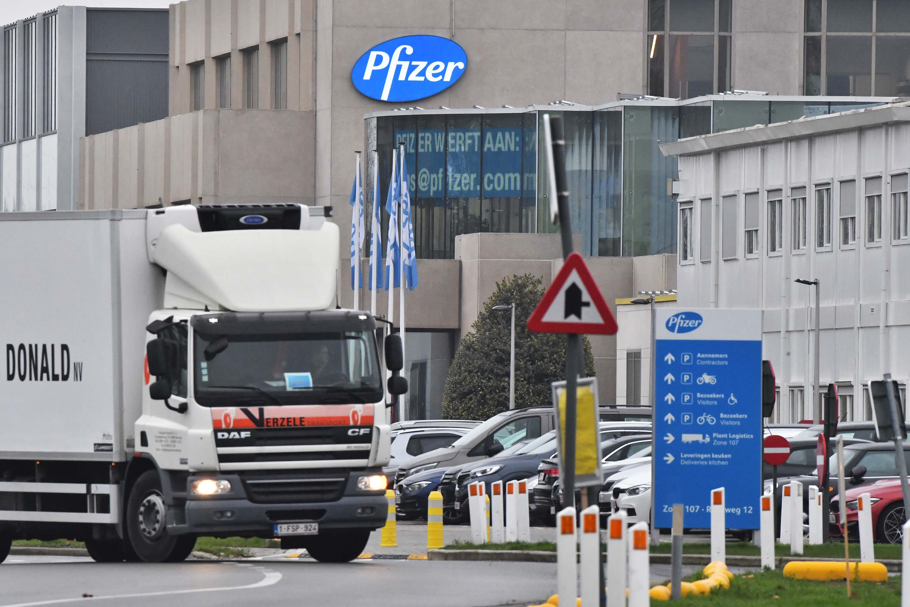 A temperature controlled cold storage truck leaves the Pfizer Inc. facility in Puurs, Belgium, on December 3.