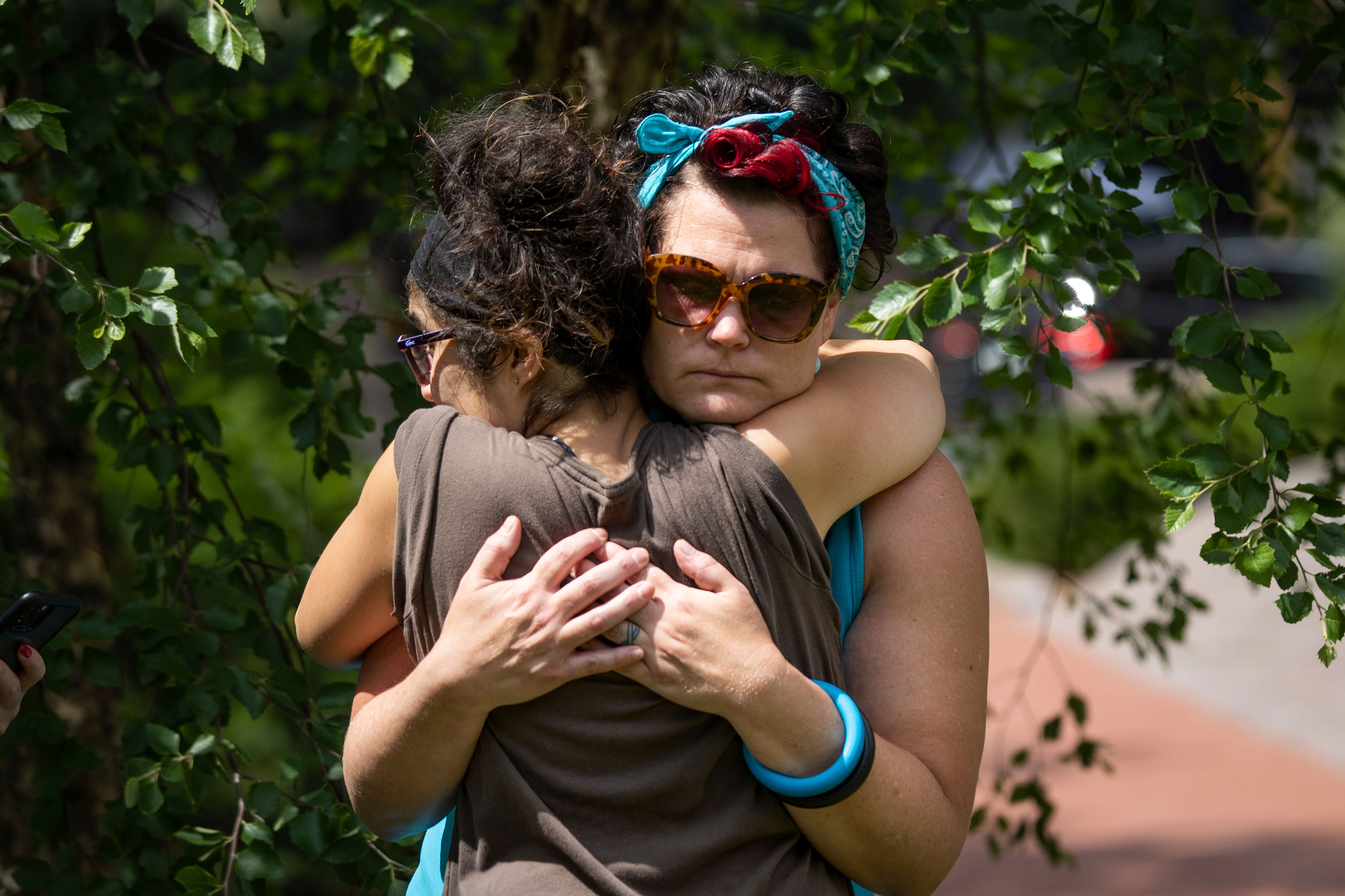 Courteney Ross, girlfriend of George Floyd, embraces another woman shortly after the sentencing of Chauvin on June 25.