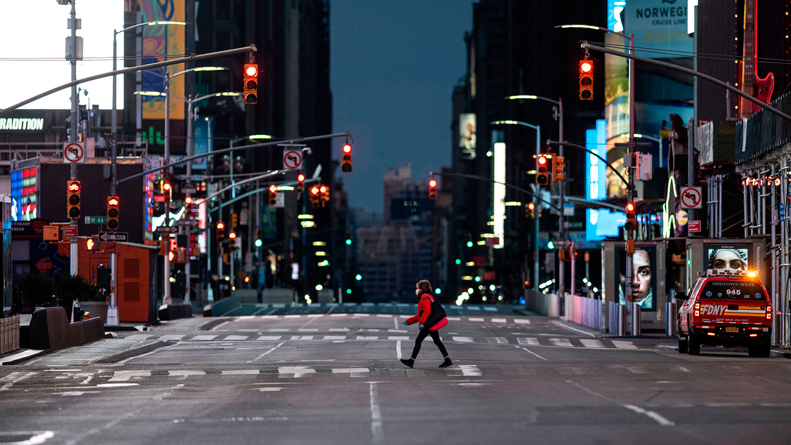 A woman walks through an almost-deserted Times Square in the early morning hours on April 23 in New York City.