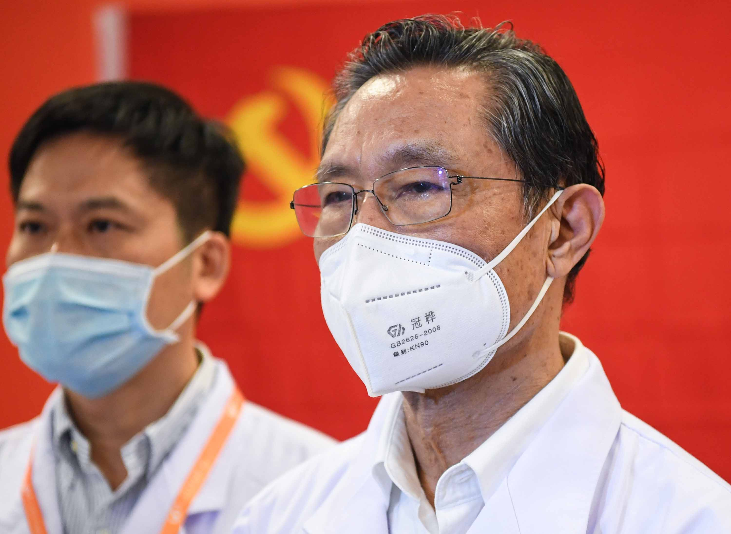 Chinese respiratory specialist Zhong Nanshan, right, attends an event in Guangzhou, China, on March 2.