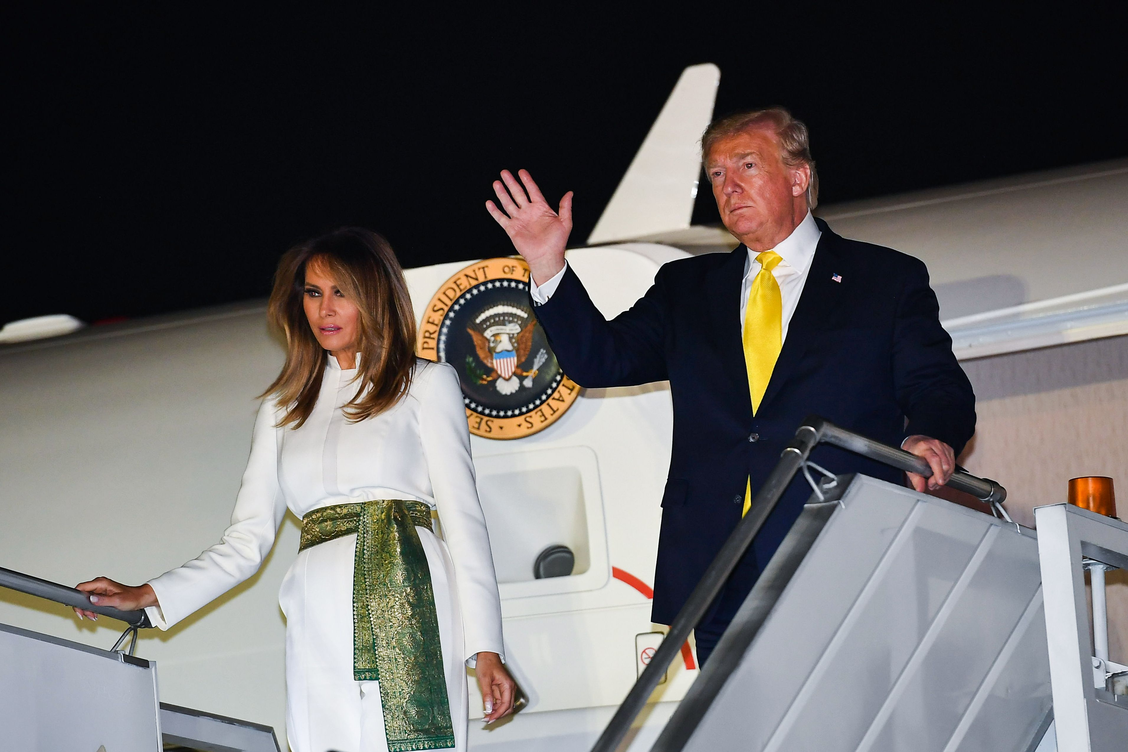 US President Donald Trump and the first lady disembark in New Delhi on Monday evening.