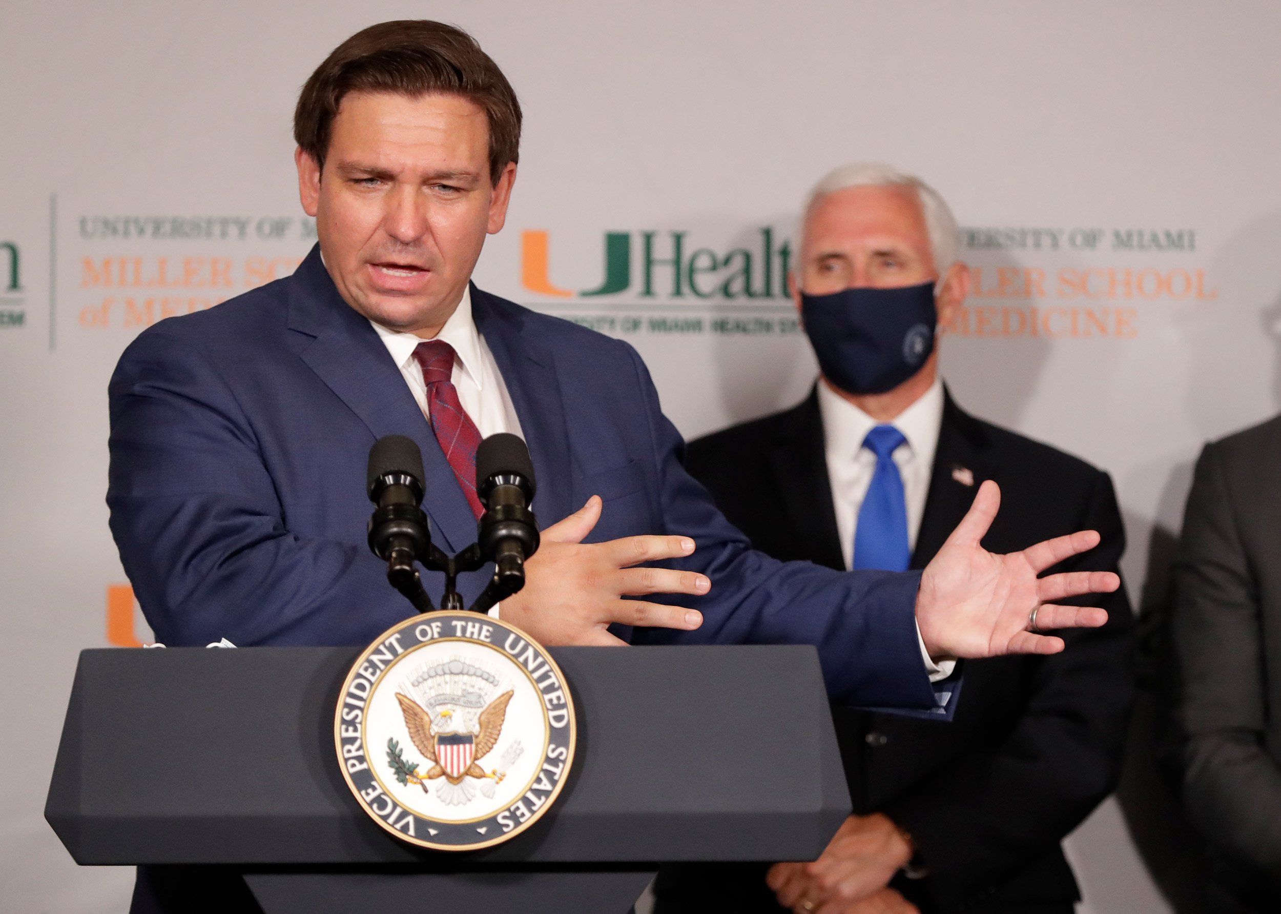 Florida Gov. Ron DeSantis, left, speaks during a news conference as Vice President Mike Pence at the University of Miami Miller School of Medicine Don Soffer Clinical Research Center on July 27 in Miami.