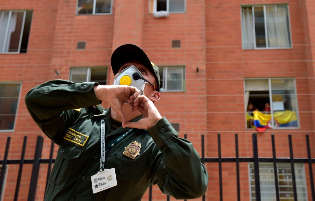 A police officer dances encouraging people to follow him from their balconies and windows as the force visits the neighbourhood to cheer people up during the lockdown imposed a preventive measure to curb the spread of the novel coronavirus in Bogota, on April 8.
