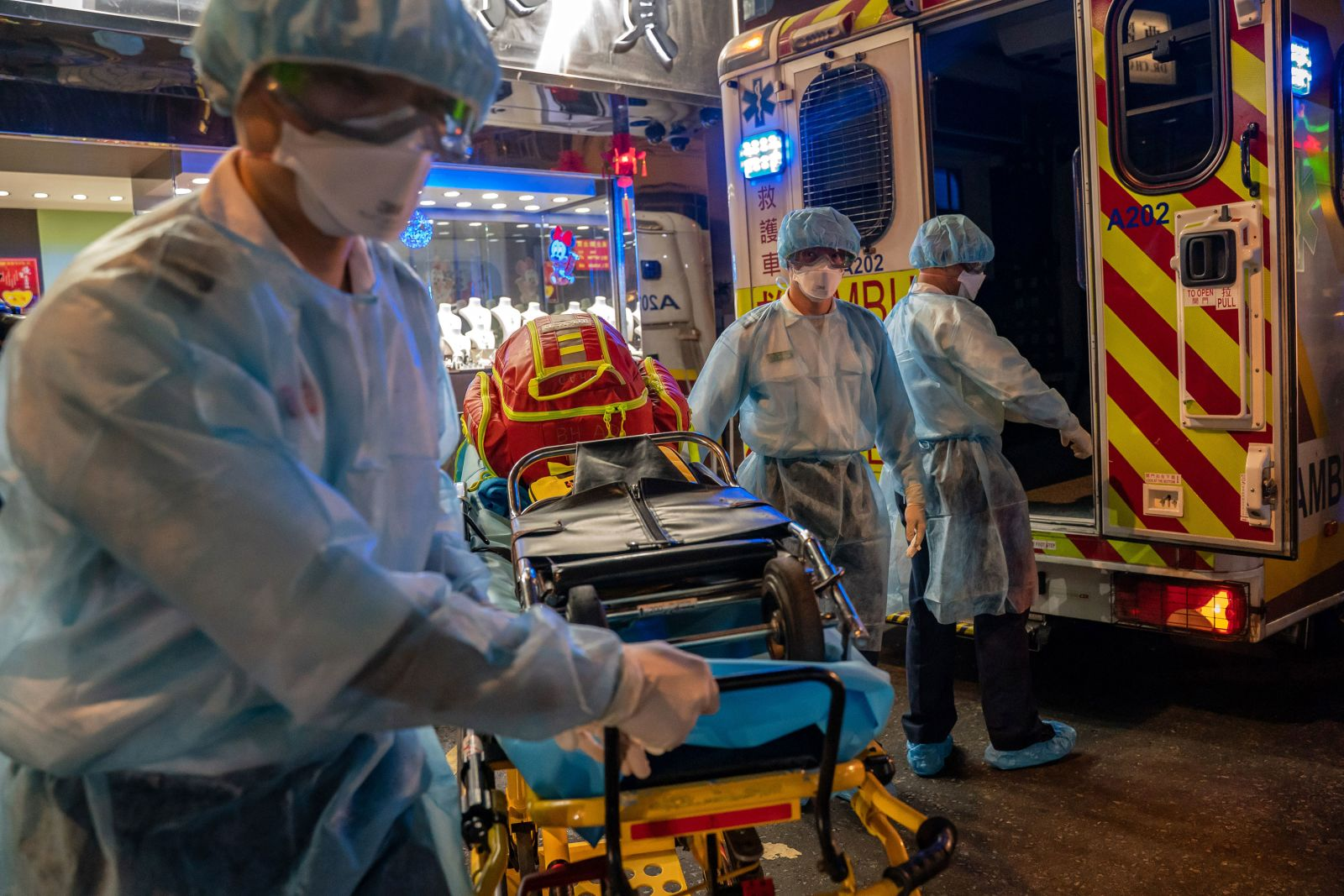 Paramedics carry a stretcher off an ambulance in Hong Kong on Sunday, February 23.
