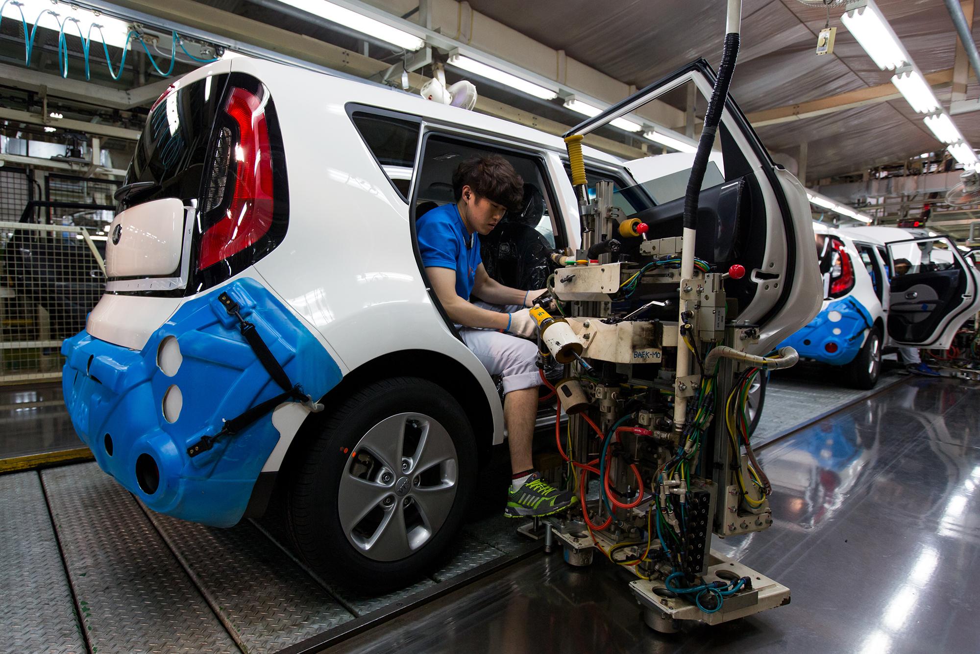 An employee works on a Kia Motors production line at the company's plant in Gwangju, South Korea, on Friday, July 8, 2016.