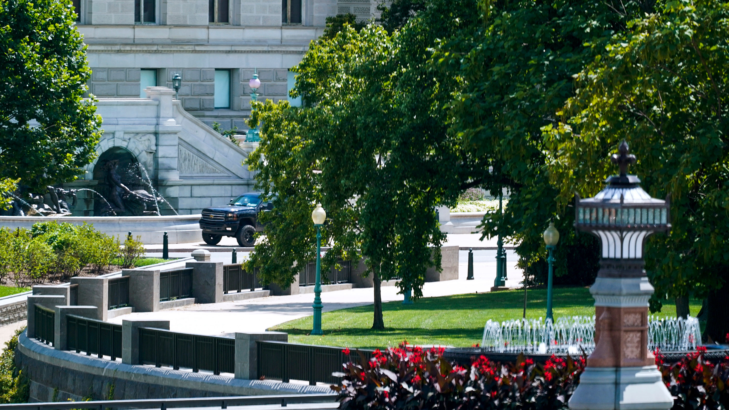 A pickup truck is seen parked on the sidewalk in front of the Library of Congress' Thomas Jefferson Building on August 19.