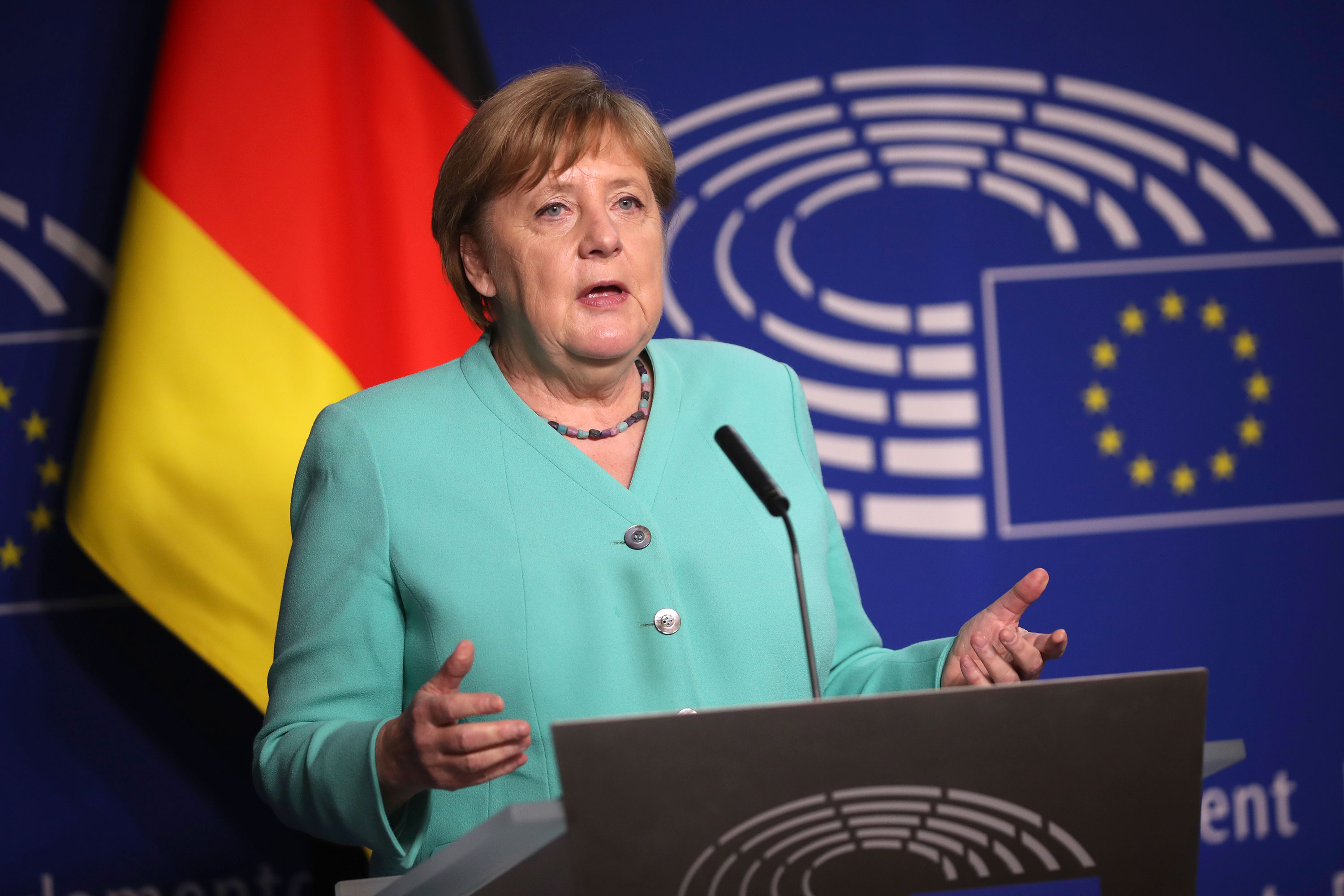 German Chancellor Angela Merkel speaks as she arrives at the European Parliament on July 8 in Brussels, Belgium.