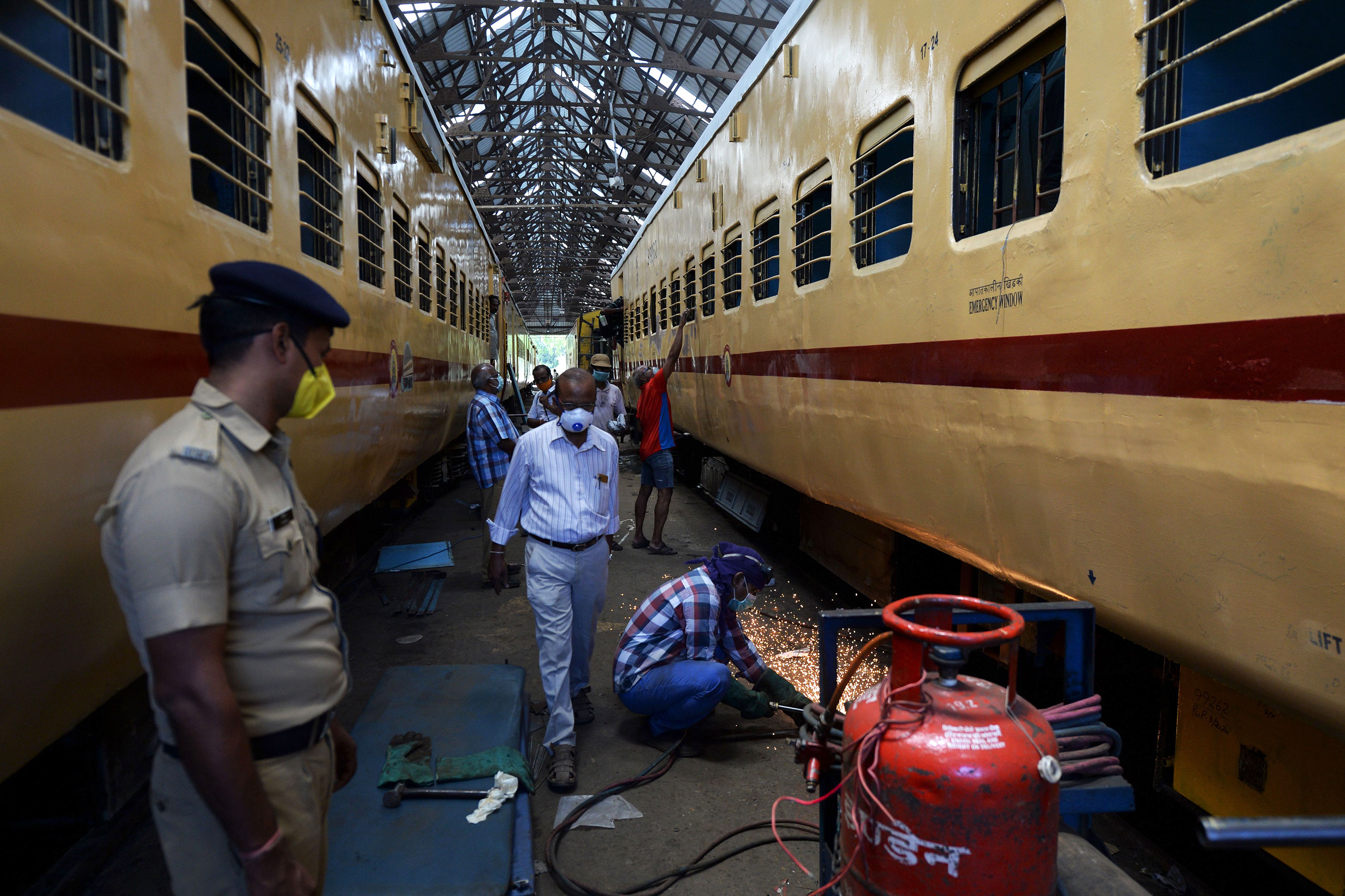Workers prepare train coaches to be used as temporary isolation wards for coronavirus patients in Chennai, India on March 30.