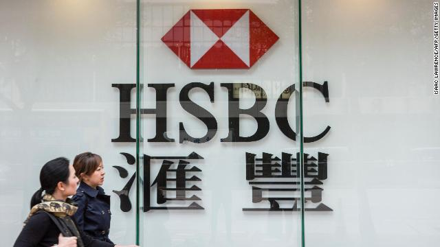 Pedestrians walk past HSBC in the Admiralty district of Hong Kong.