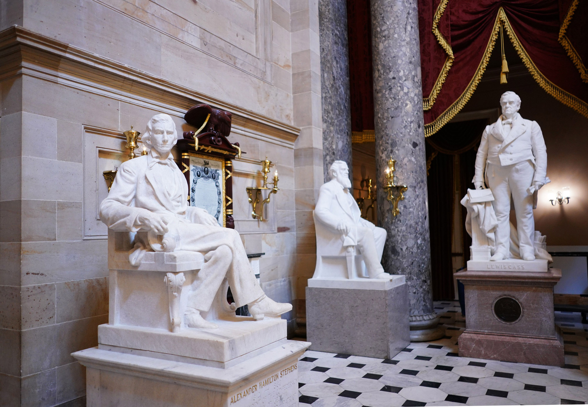 A statue of Alexander Hamilton Stephens (L), vice president of the Confederate States, by artist Gutzon Borglum is seen in Statuary Hall of the US Capitol in Washington on June 11.