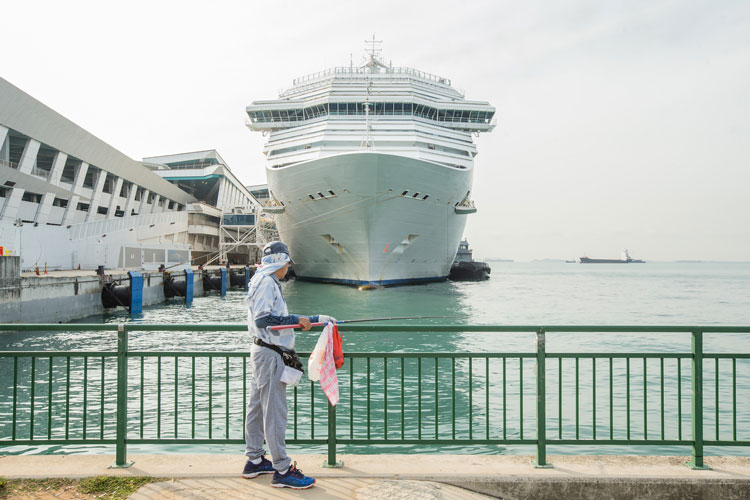 The cruise ship Costa Fortuna is seen docked in Singapore on March 10, after the vessel was turned away from ports in Malaysia and Thailand amid fears of the novel coronavirus.