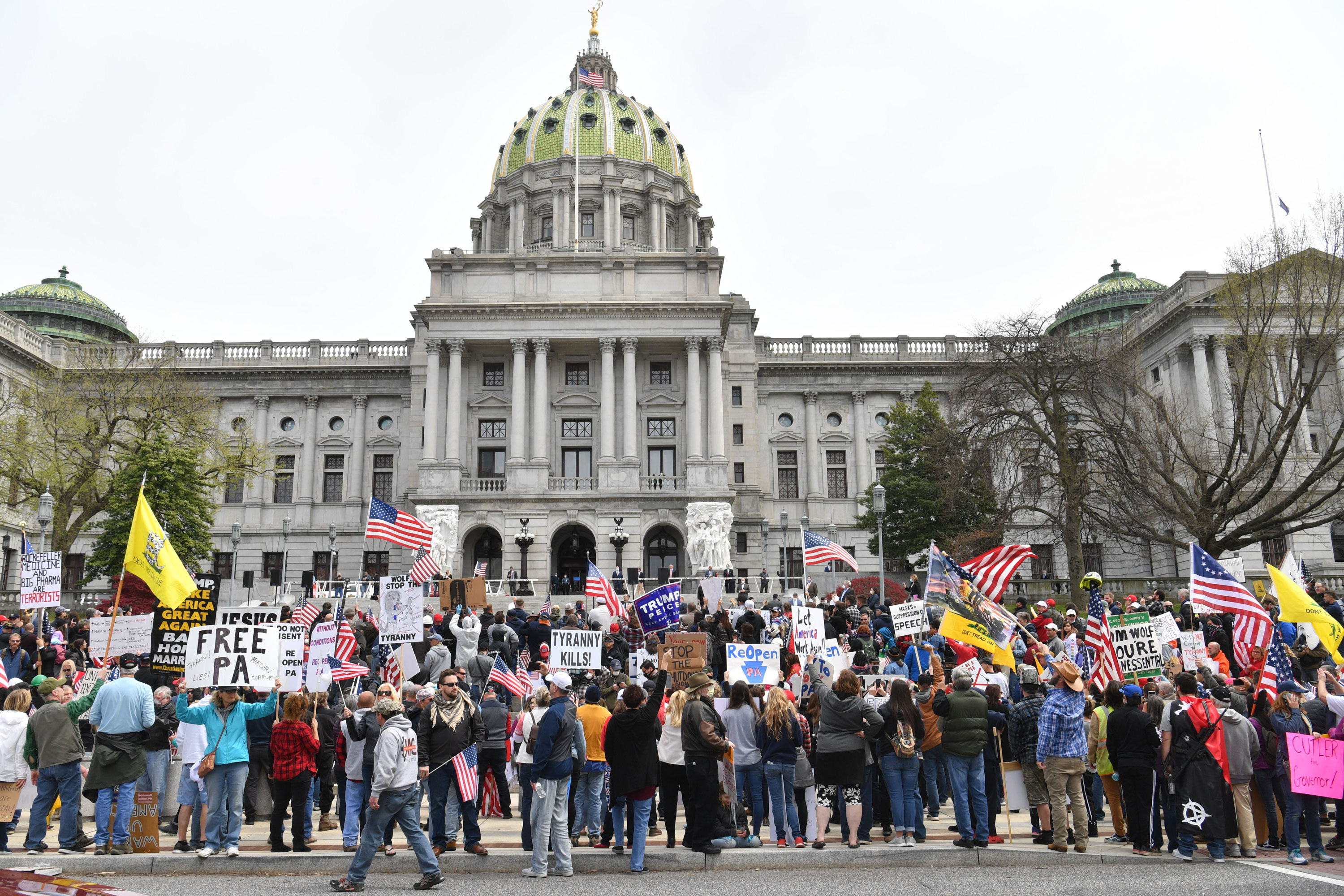 "People take part in a ""reopen"" Pennsylvania demonstration on April 20 in Harrisburg, Pennsylvania."