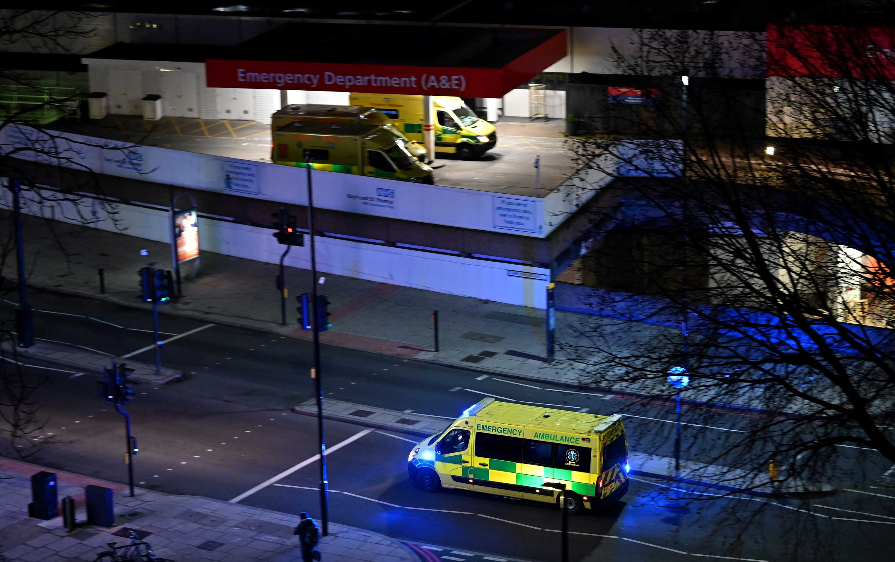 Paramedics from the British Emergency Ambulance Response Service (BEARS) transport a patient to Guy's and St Thomas' Hospital in London on January 7.