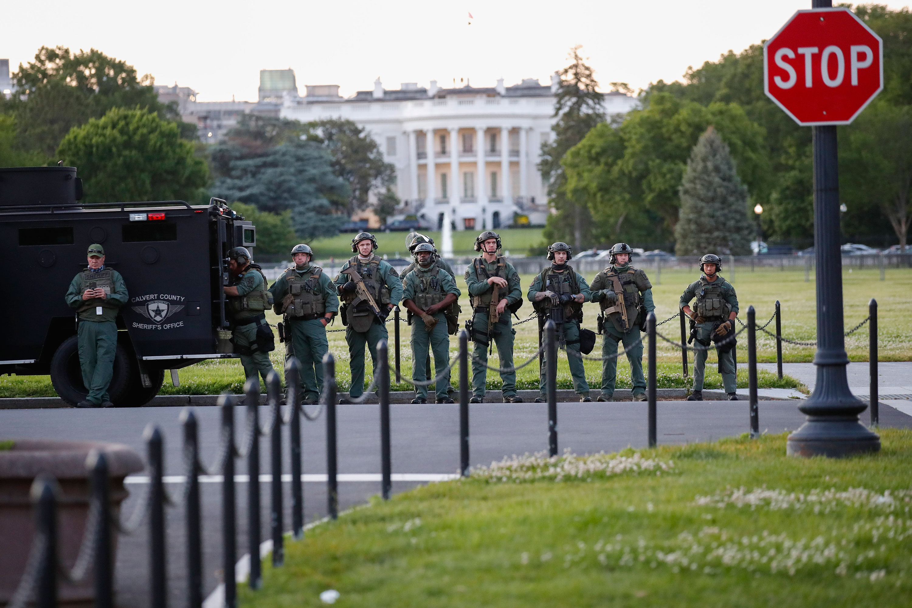 Law enforcement officers from Calvert County Maryland Sheriff's Office stand near the White House on May 31 in Washington.