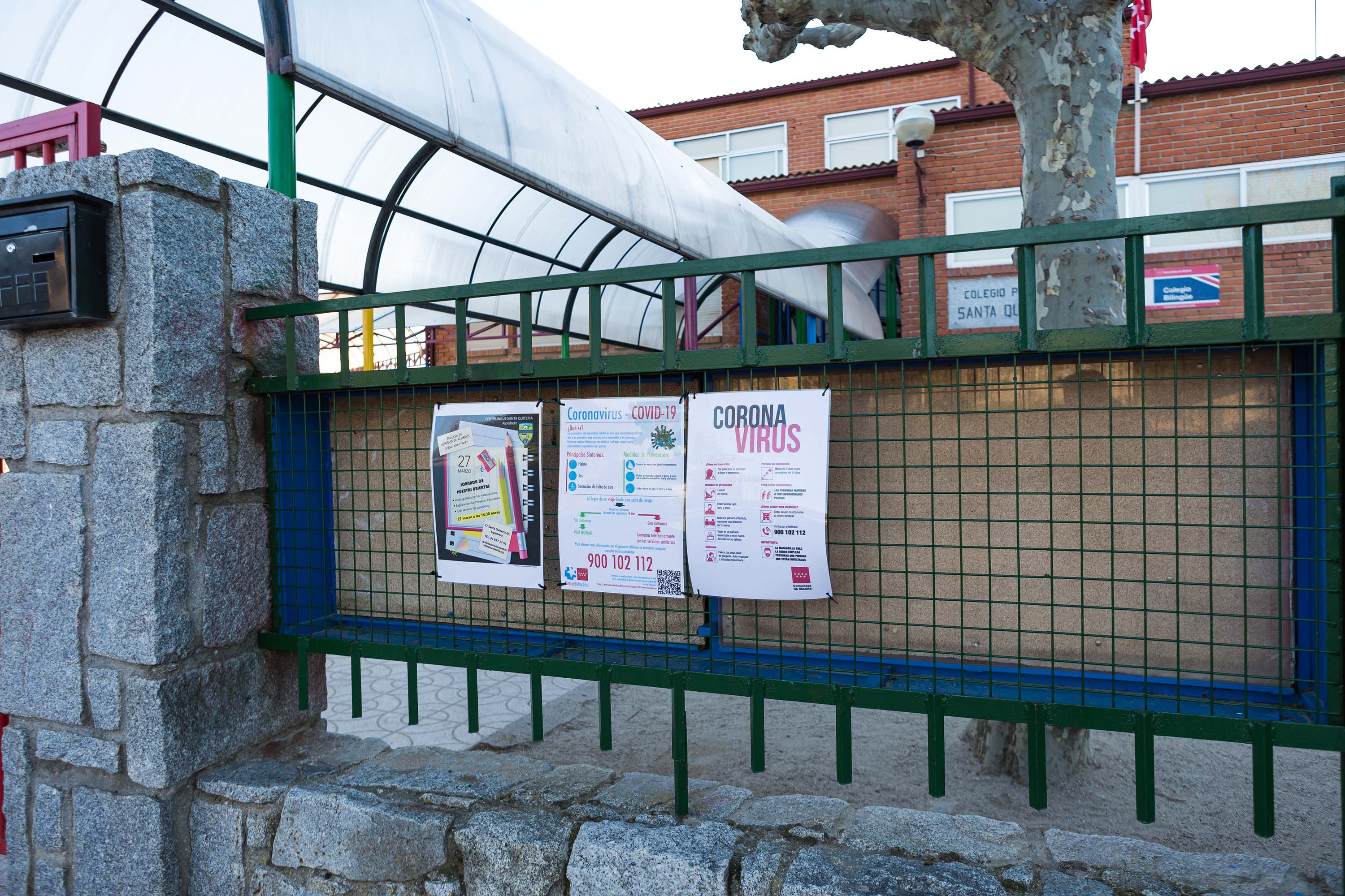 A sign with information about coronavirus is posted at a closed school in Madrid, Spain, on Wednesday.