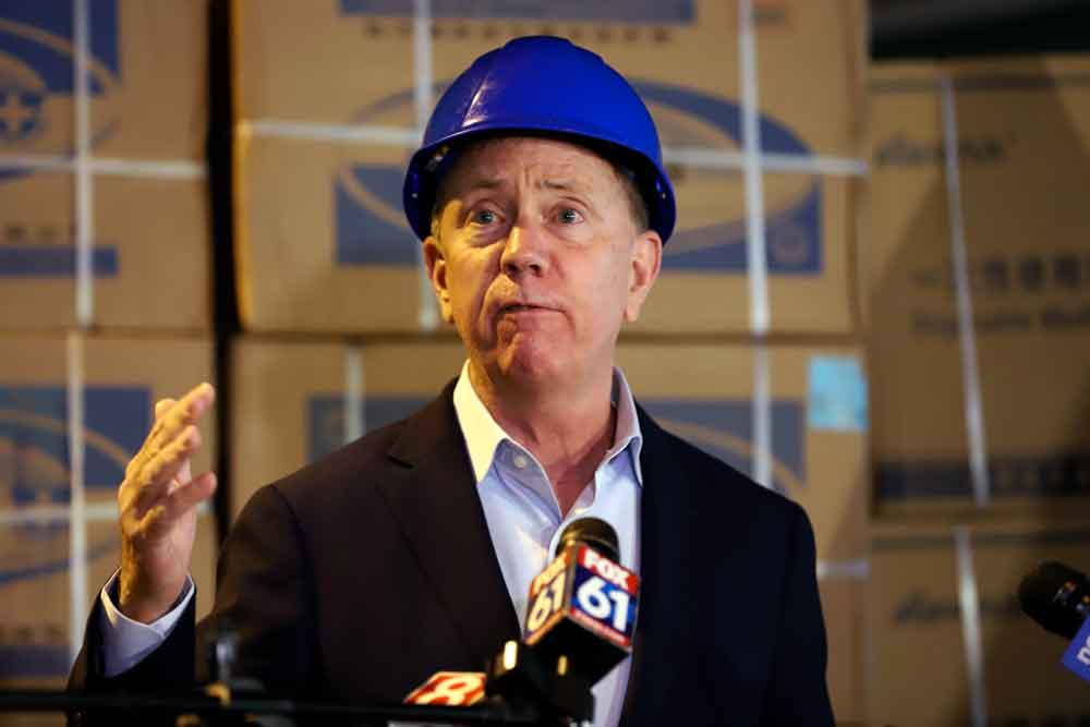 Connecticut Gov. Ned Lamont speaks to the media about the shipment of personal protective equipment from China donated to the state to aid Connecticut's frontline workers on Tuesday, May 12, in New Britain, Connecticut.
