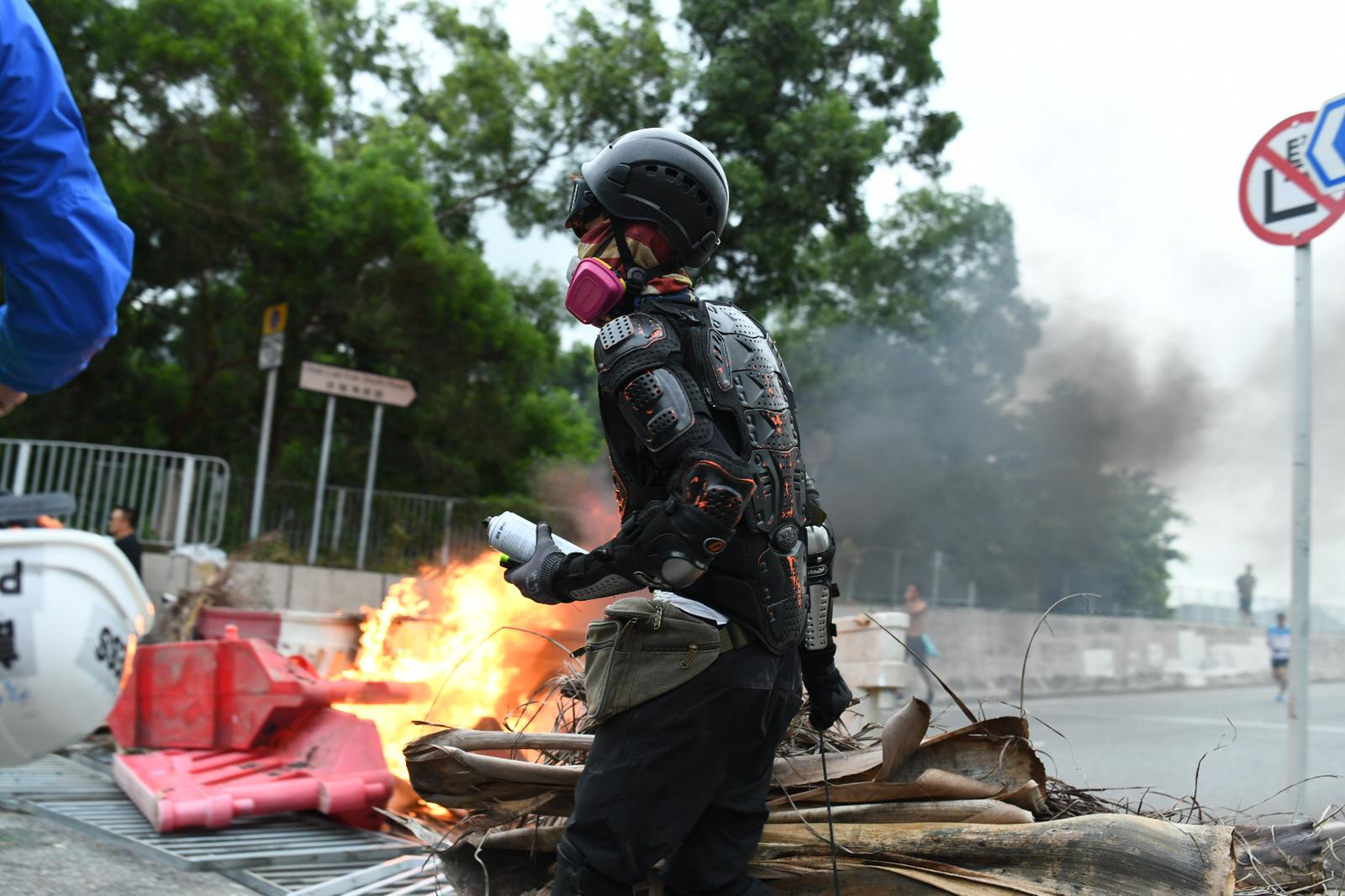 A protester by a fire set near Hong Kong's airport on September 1, 2019.