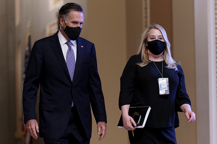Sen. Mitt Romney walks with his chief of staff on the way to the Senate chamber as arguments continue in former President Donald Trump's second impeachment trial on Wednesday, February 10.
